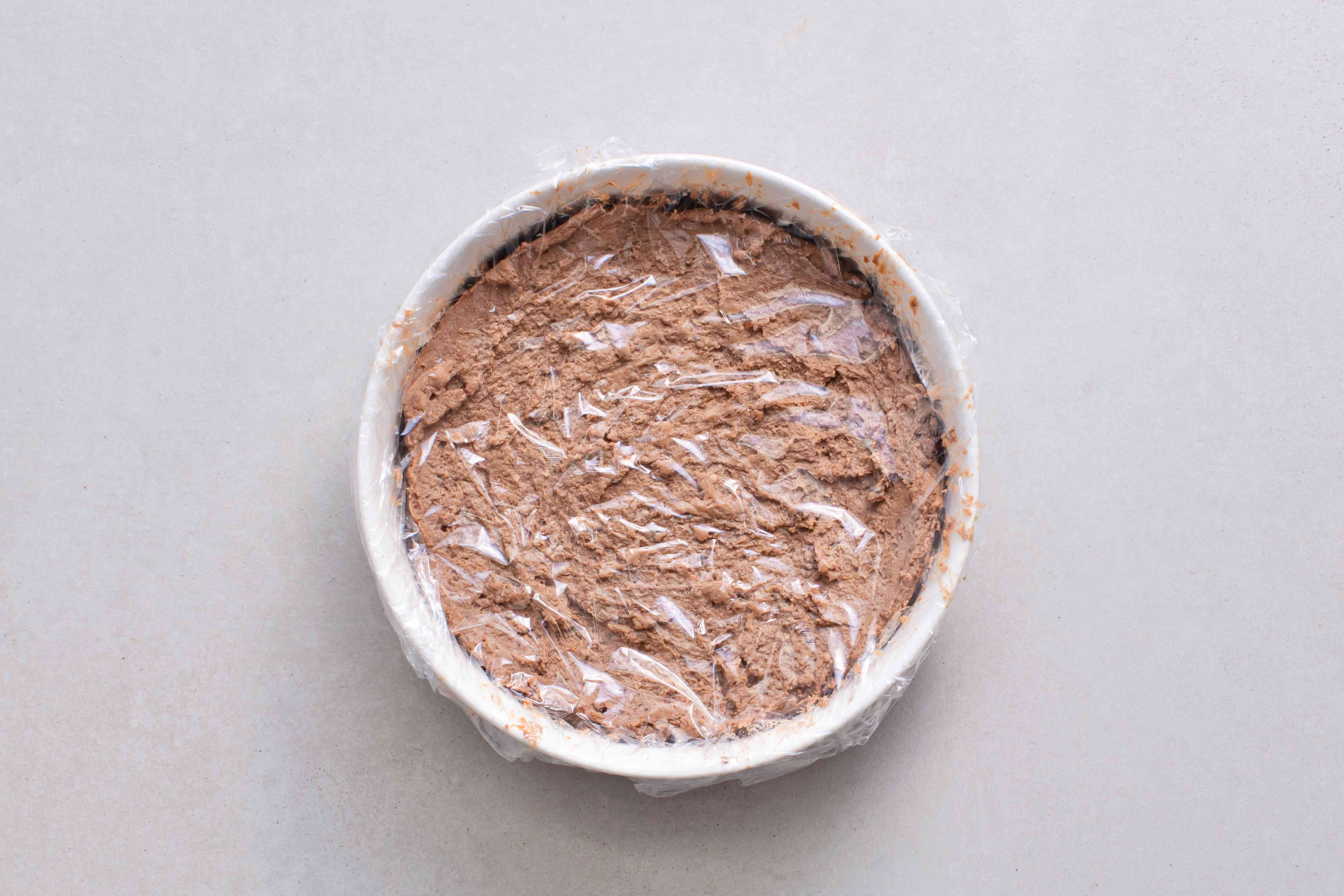 pate in a bowl, covered with plastic wrap