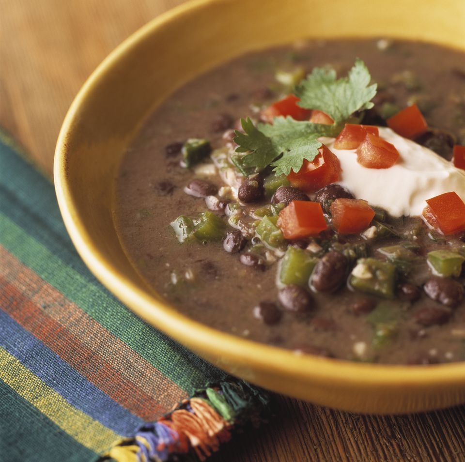Bowl of black bean soup with sour cream