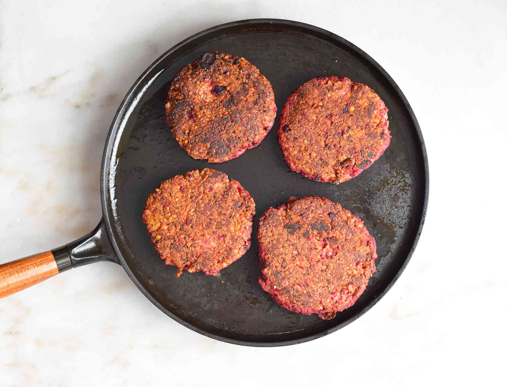 impossible burger patties cooked on a griddle