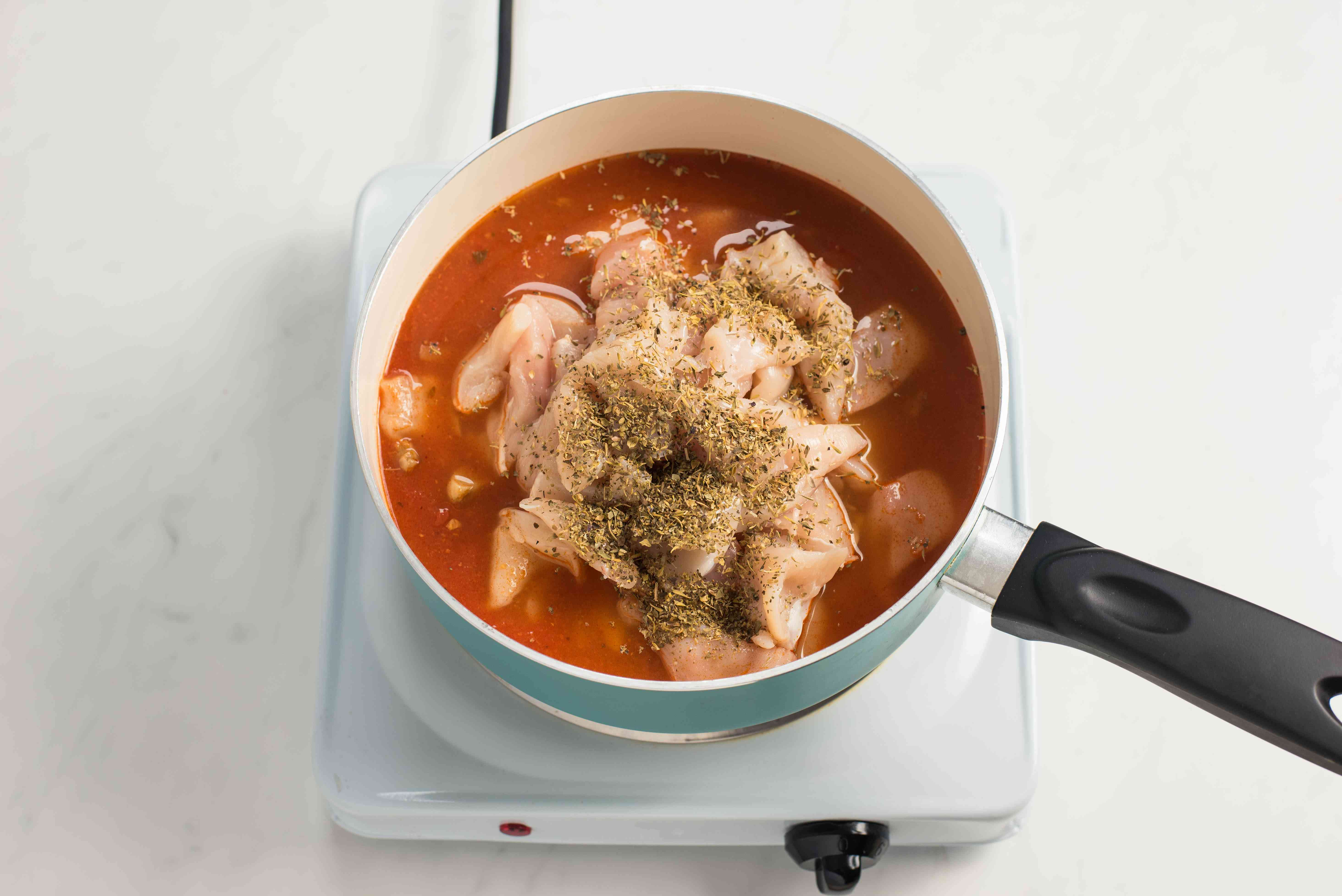 Chicken and sauce in a pot