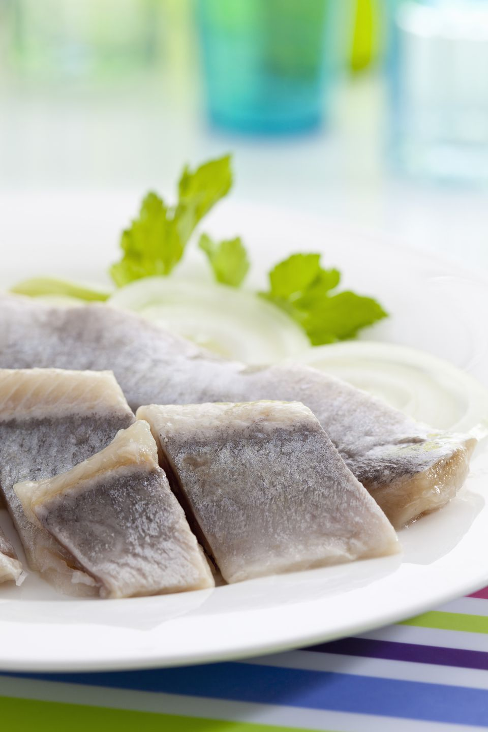 Herring in oil with onions on plate
