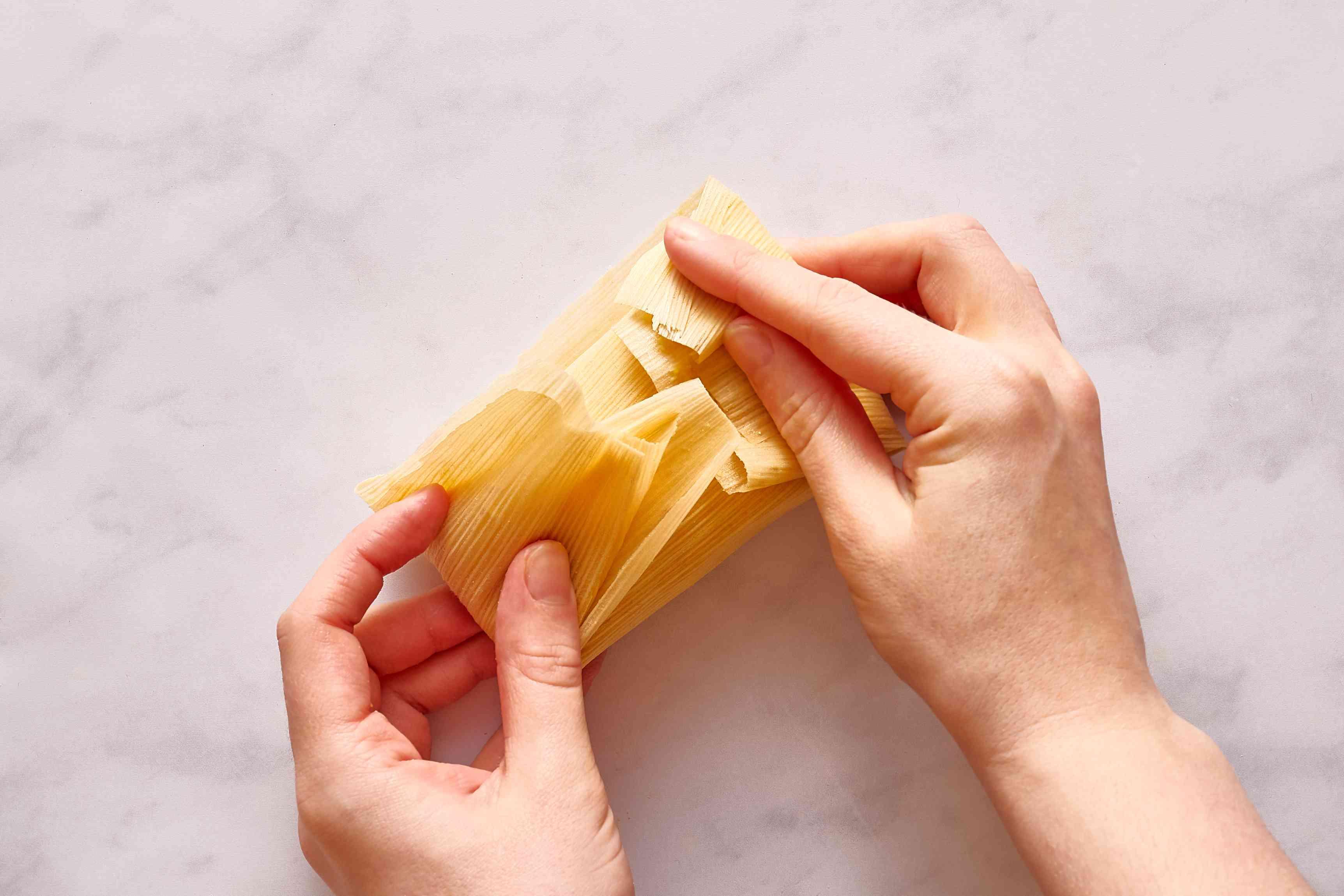 fold the husk around the masa dough