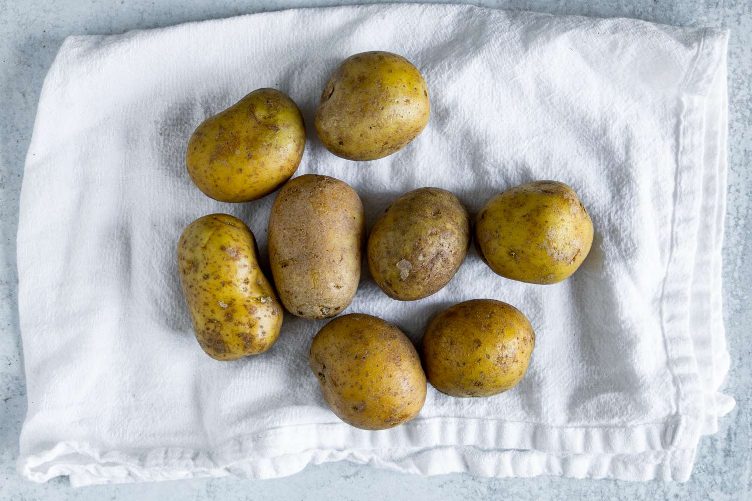 Clean potatoes on a kitchen towel
