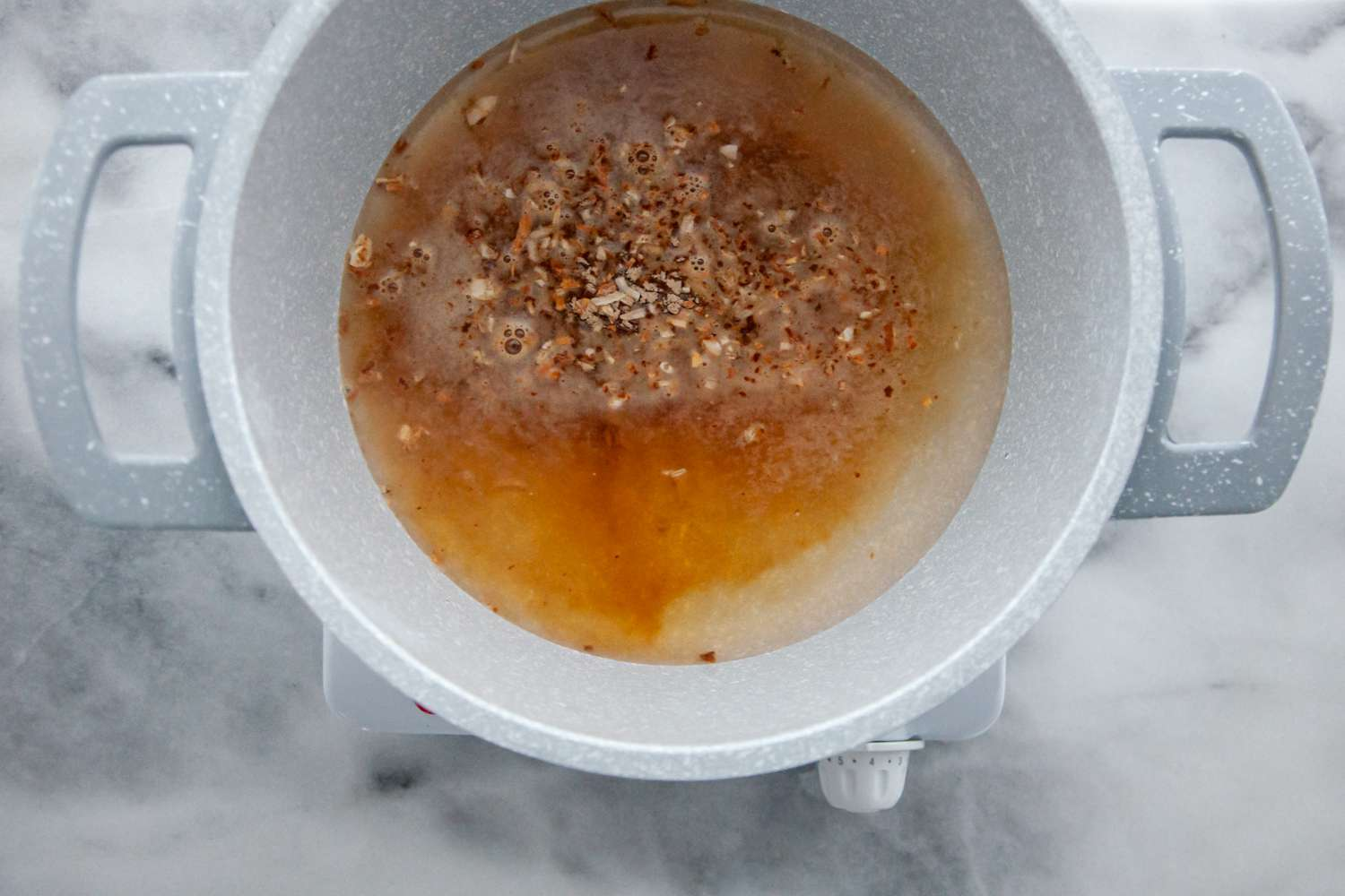 onion soup mix and water in a saucepan