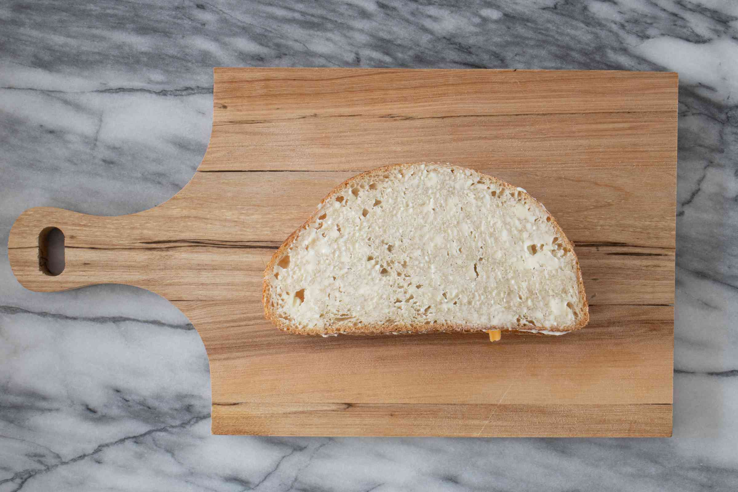 buttered sandwich on a cutting board