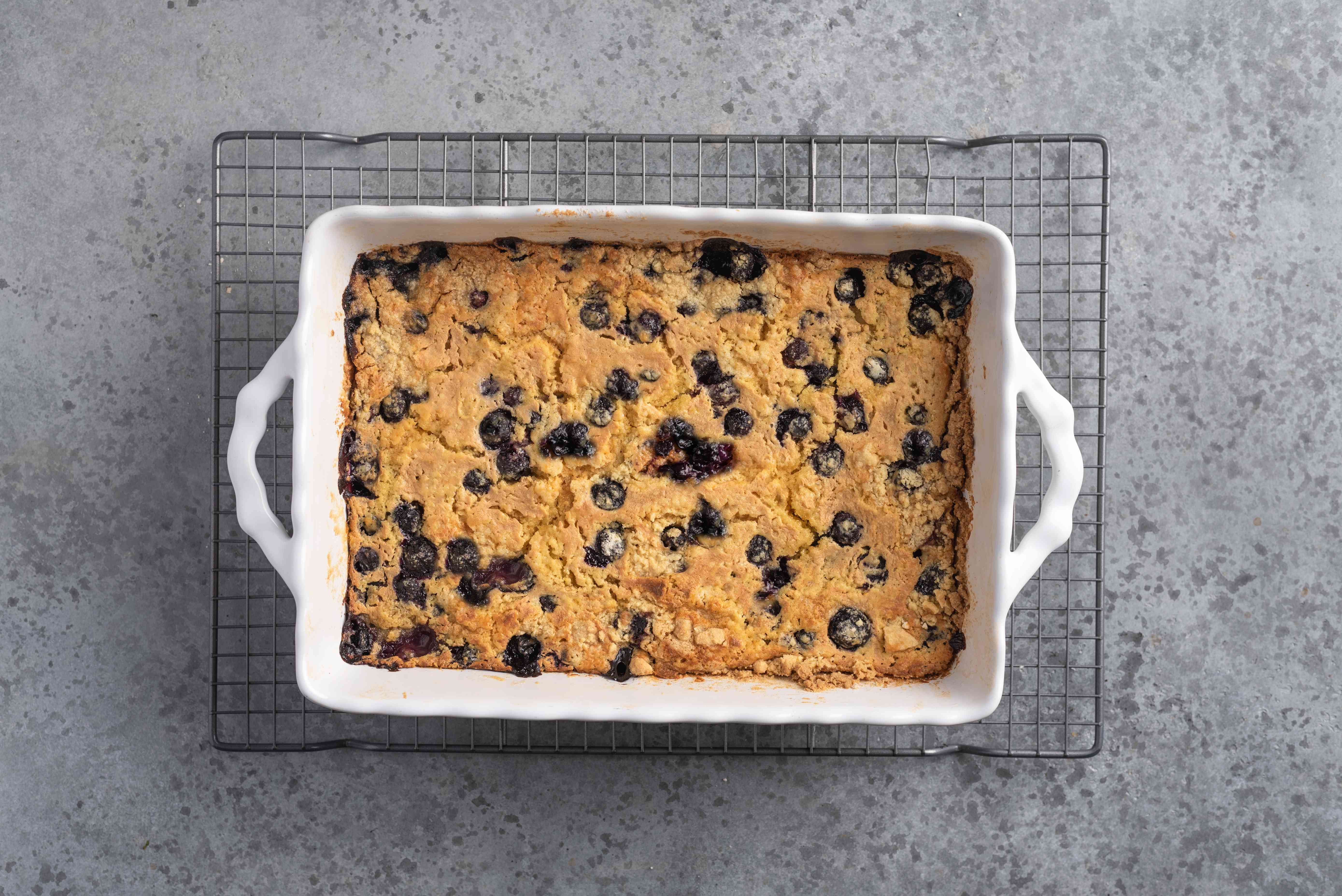 Blueberry Dump Cake in a baking dish on a cooling rack