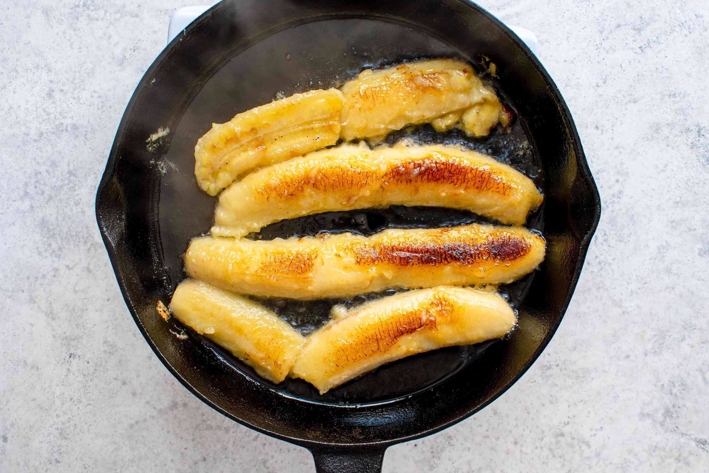 Brown the bananas in a frying pan