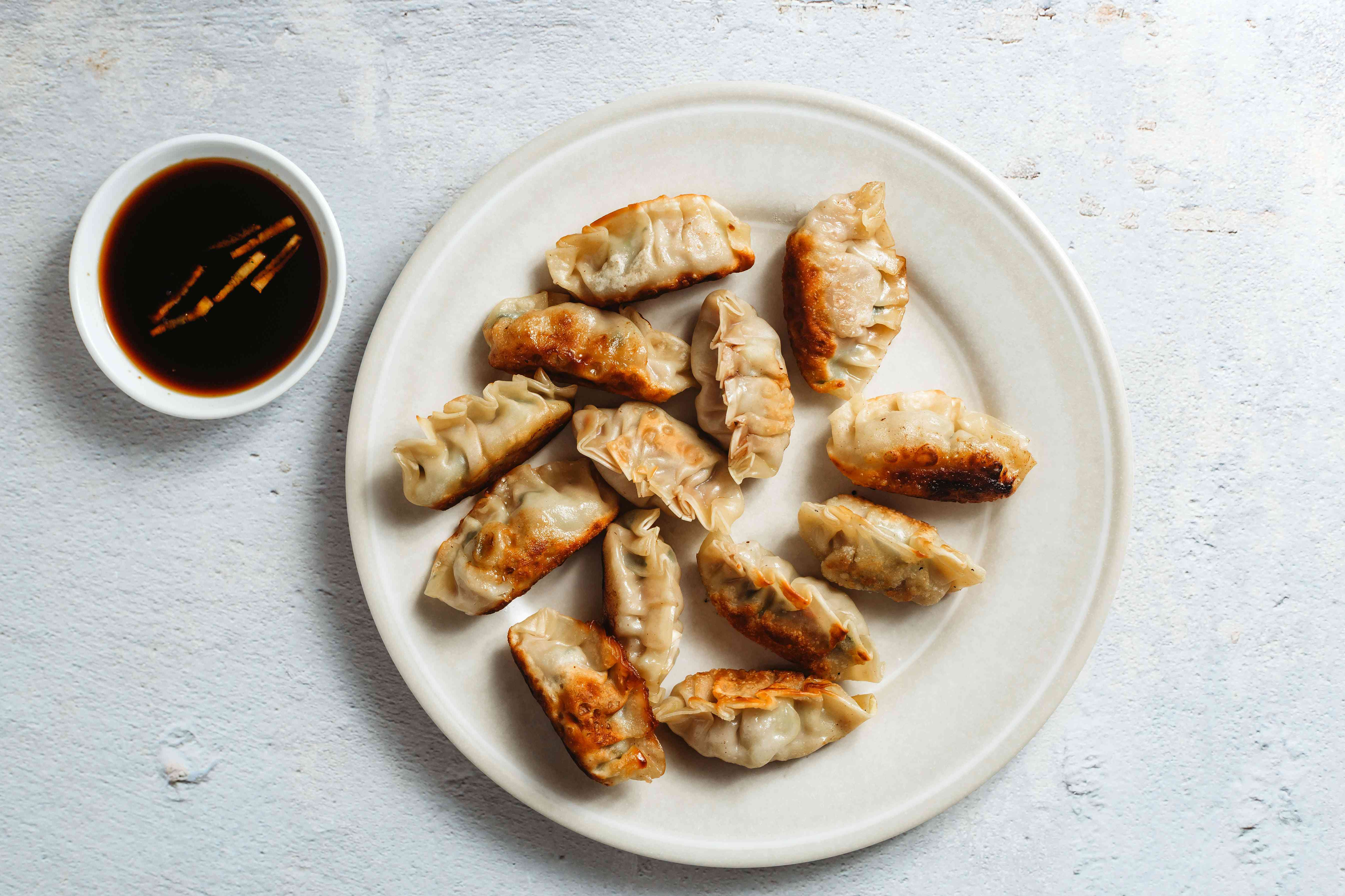 Wor Tip Cantonese Potsticker on a plate, served with sauce