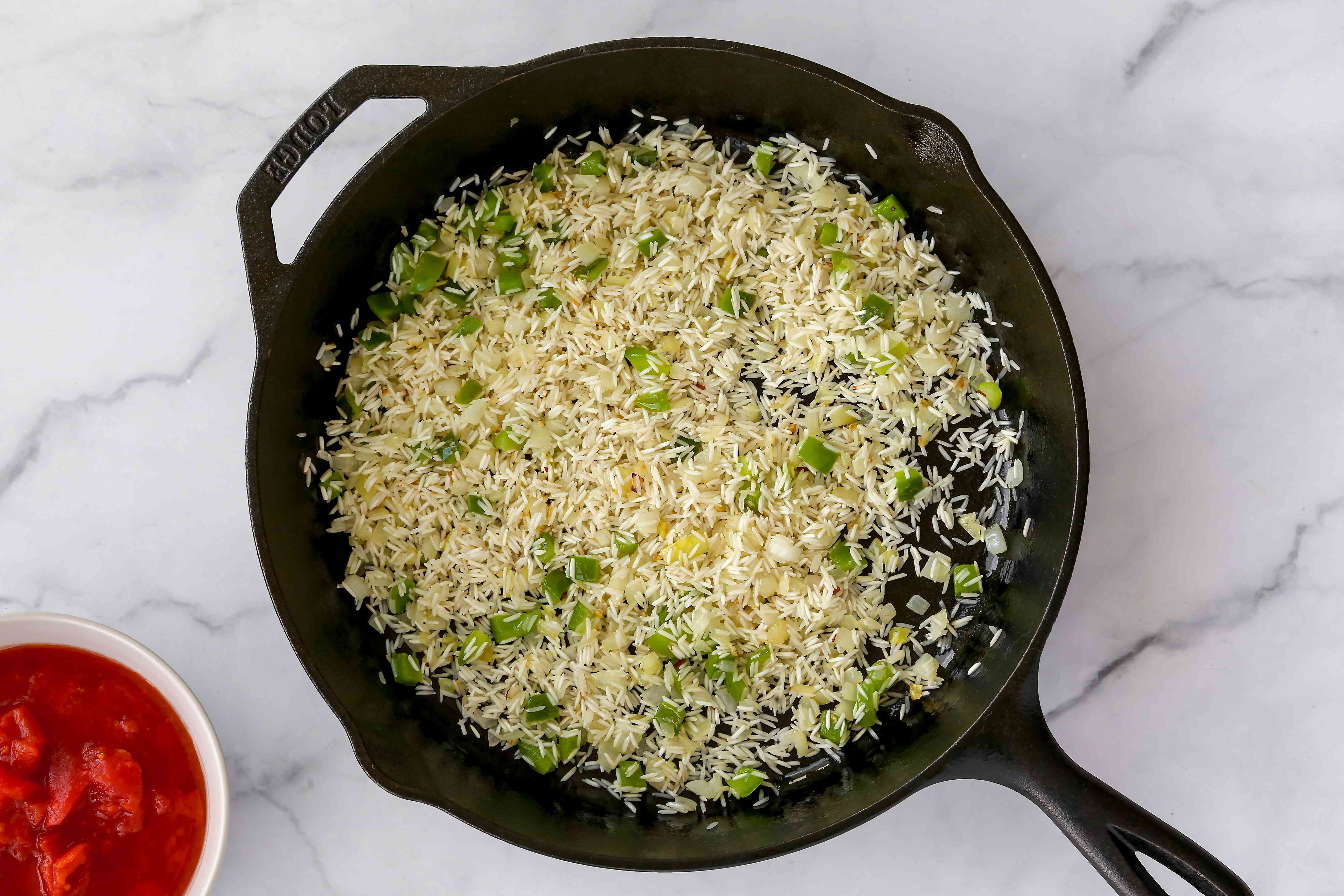 Rice and vegetables in a cast iron skillet