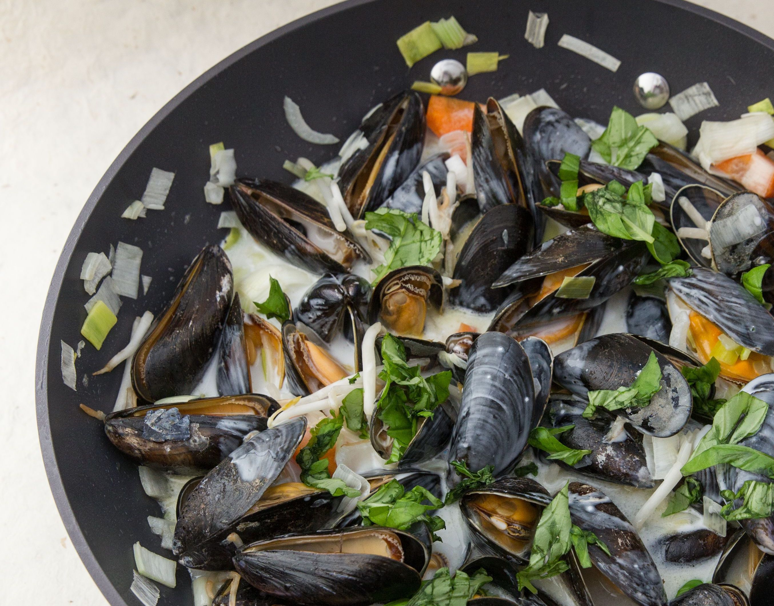 ​Thai mussels cooking in a pan