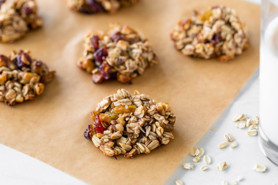 baked vegan oatmeal cookies on parchment paper