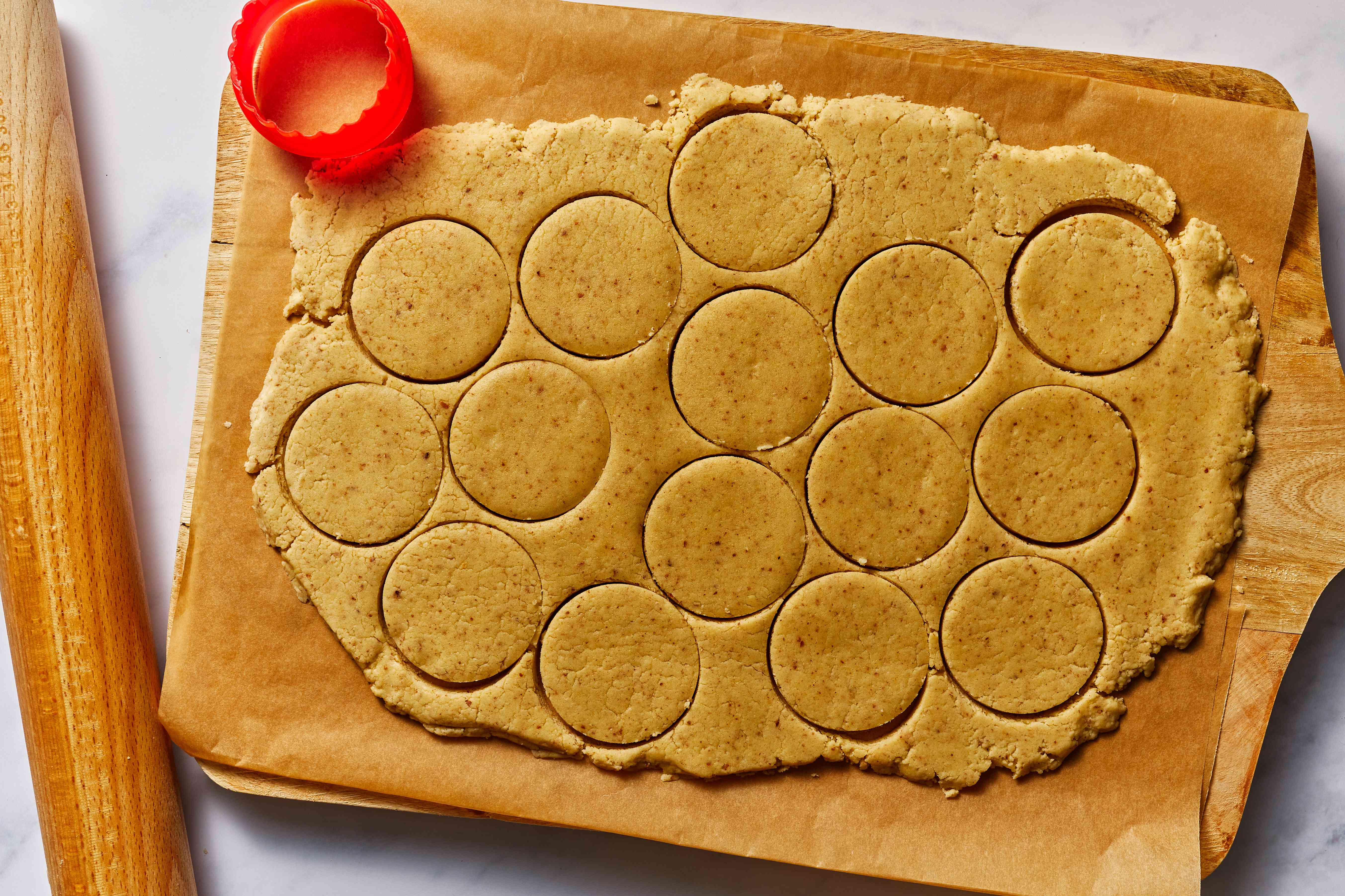 cookie cutter, cookie dough on parchment paper