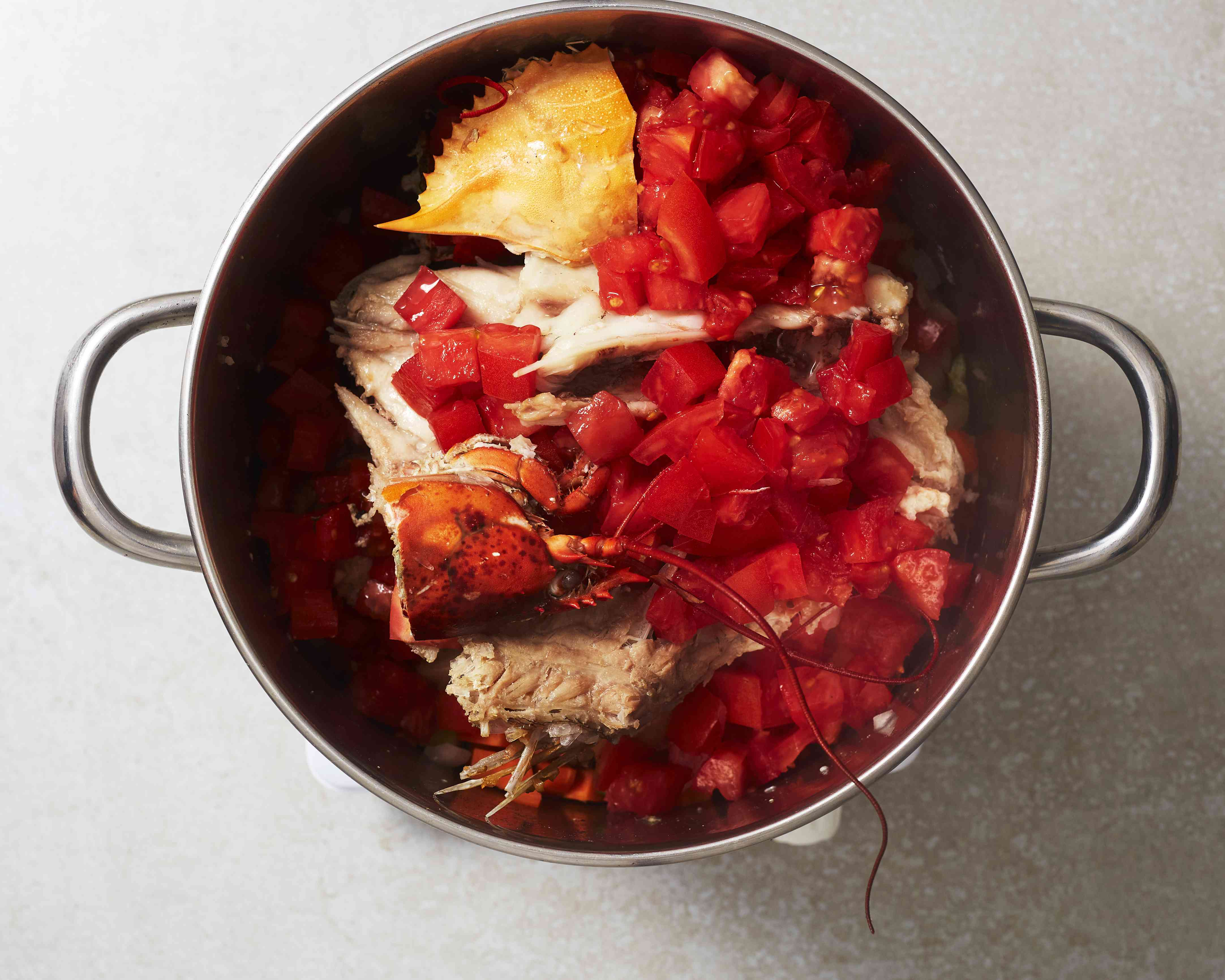 Add the tomatoes to the fish mixture and cook until soft