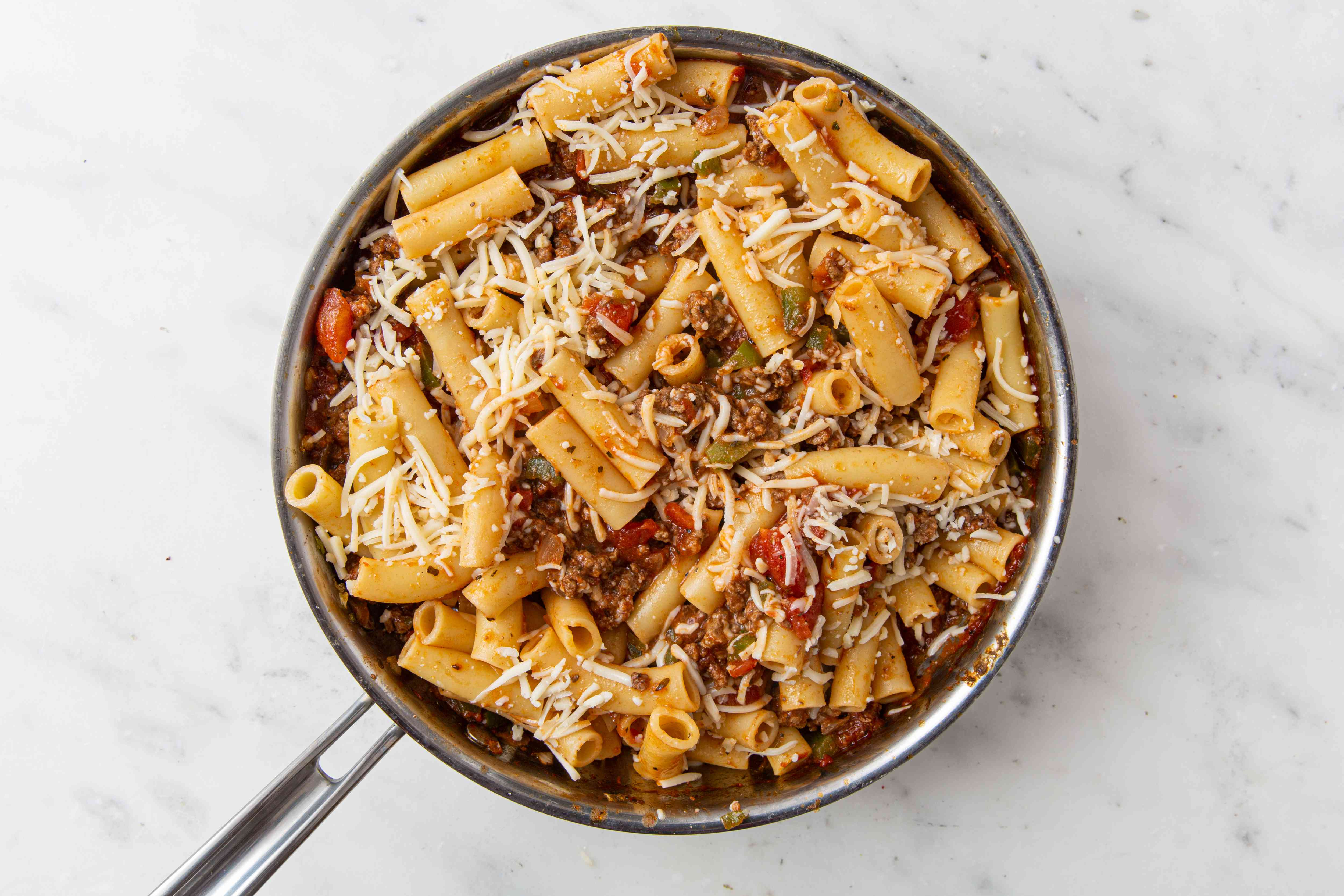 Tomato sauce, ground beef and ziti in a pan