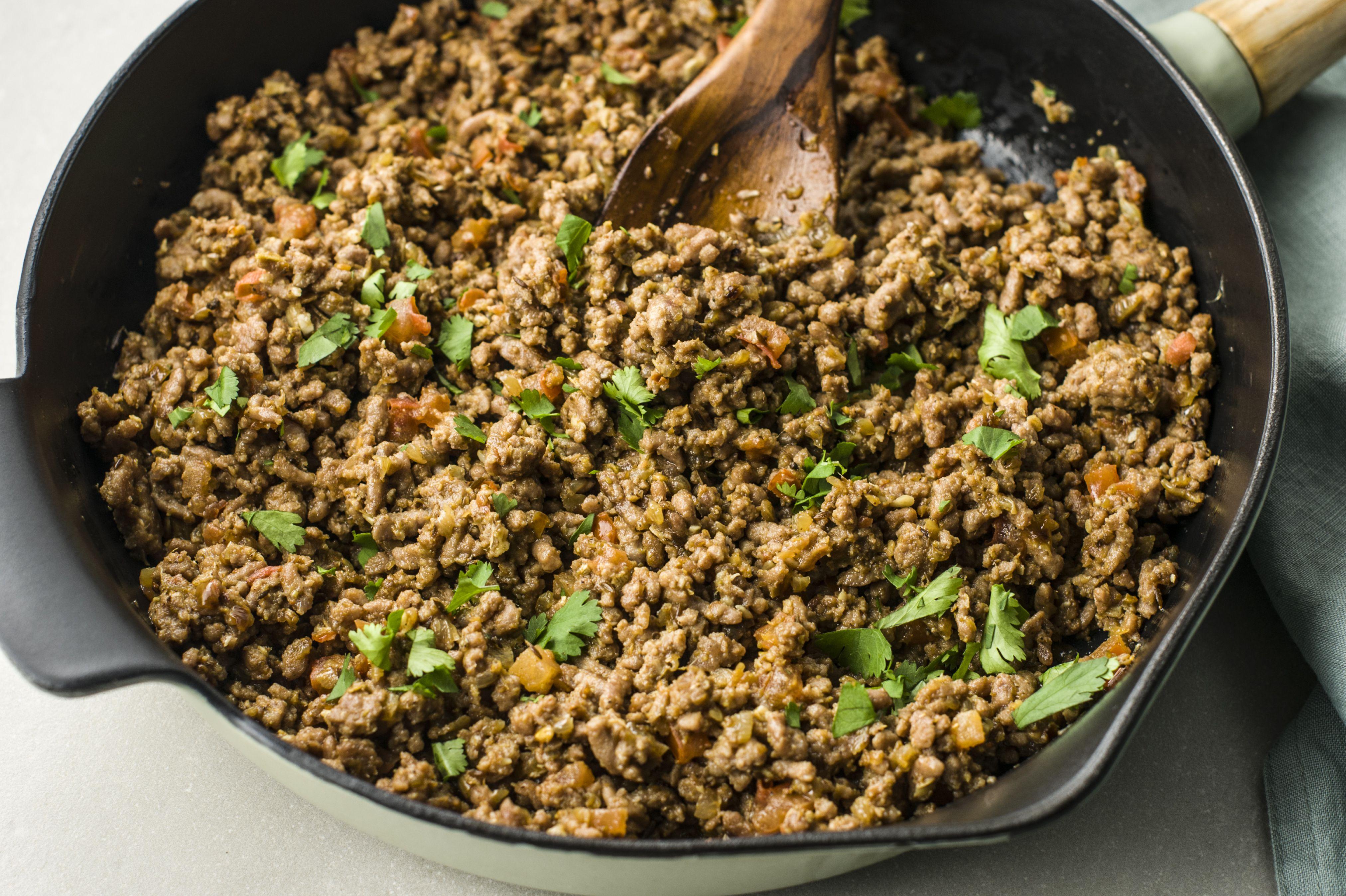 Masala kheema with chopped coriander in frying pan