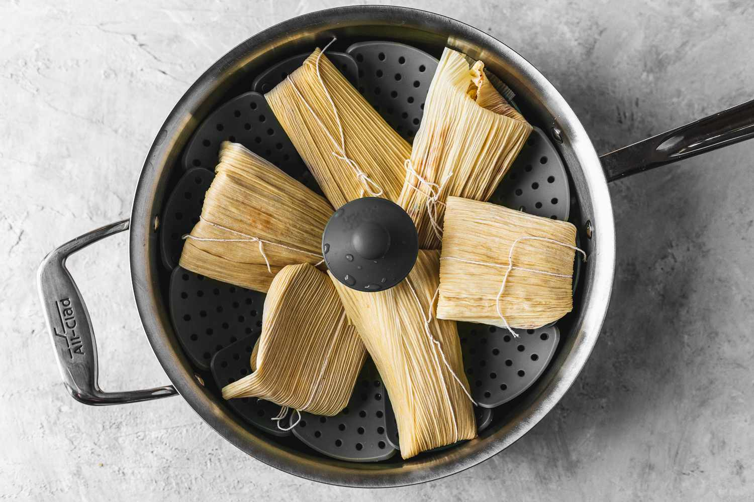 Quick and Easy Cheese Tamales in a steamer