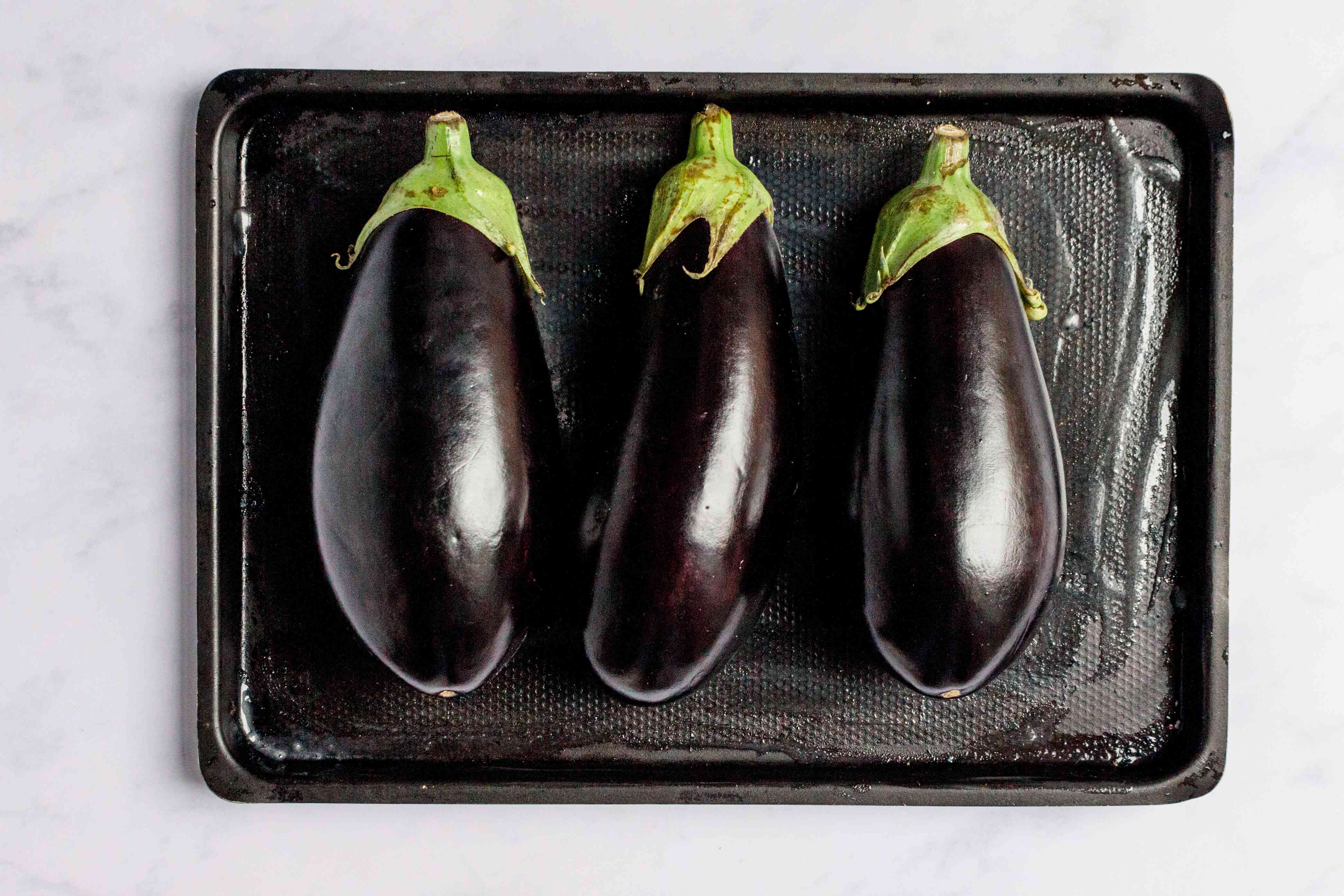 Place eggplant on a lightly greased baking sheet
