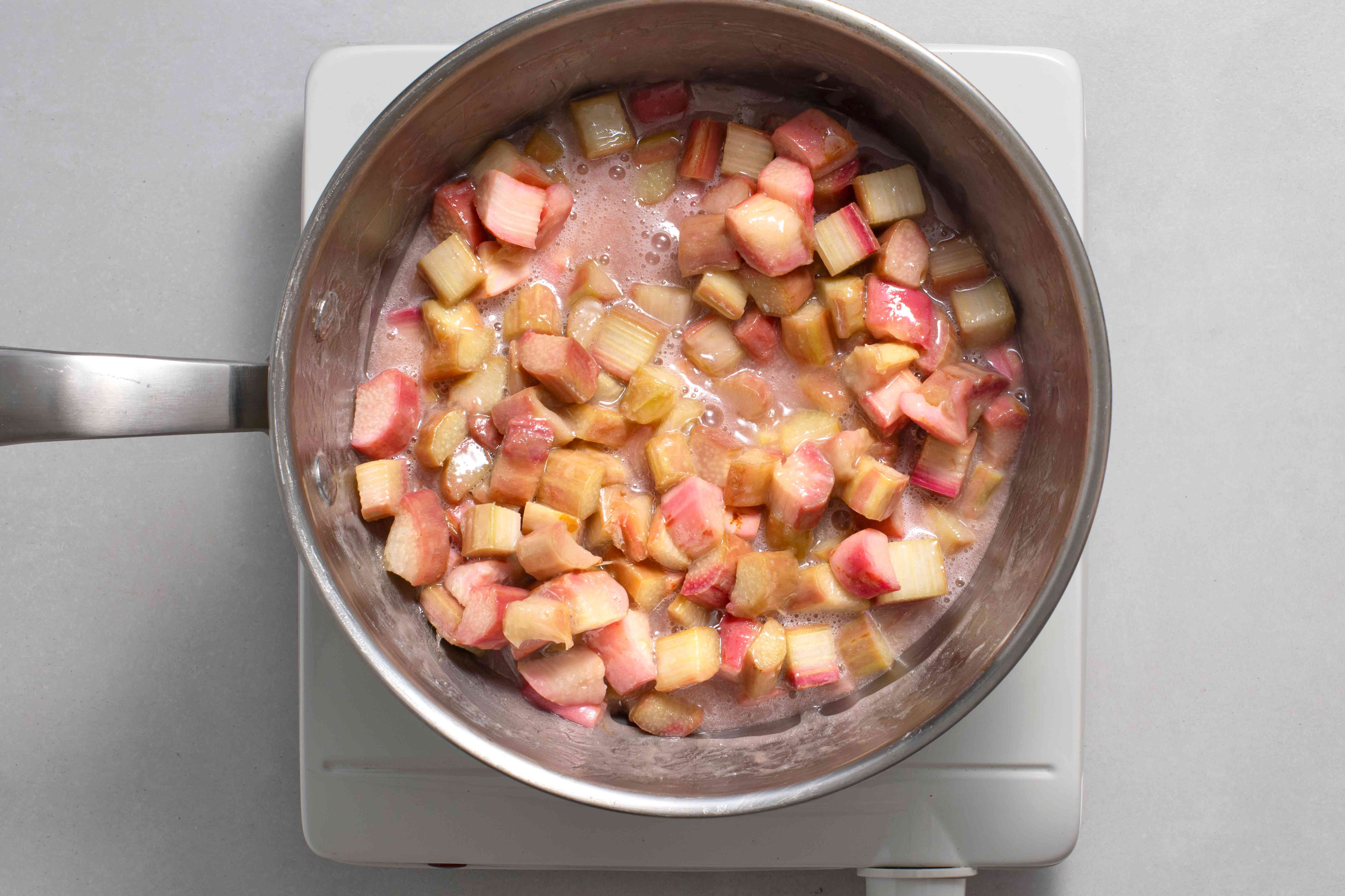 Rhubarb mixture cooking in a saucepan