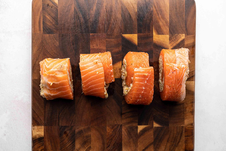 salmon pin wheels on a cutting board