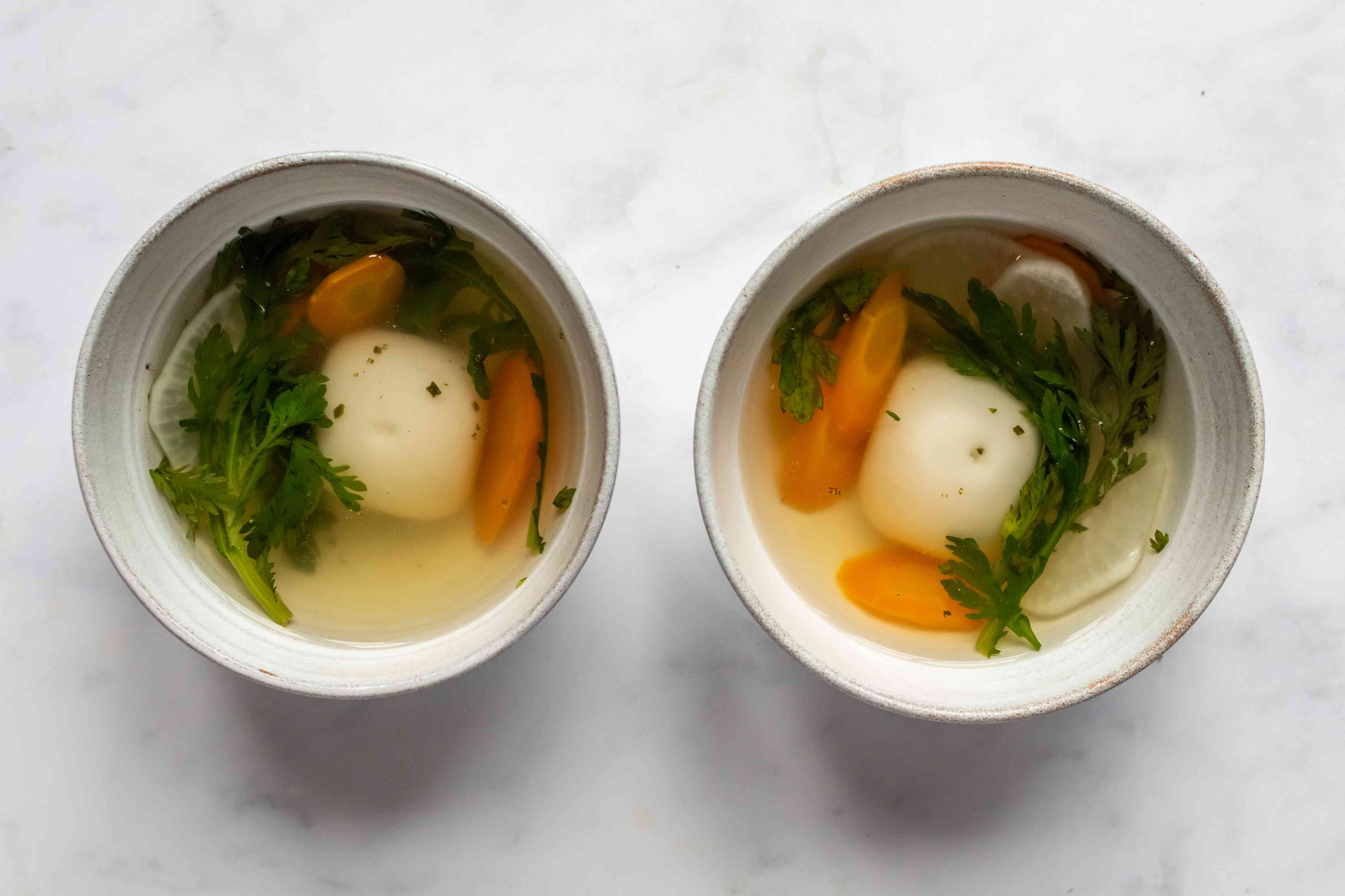 Vegan Ozoni (Japanese New Year's Soup With Rice Cake) in bowls
