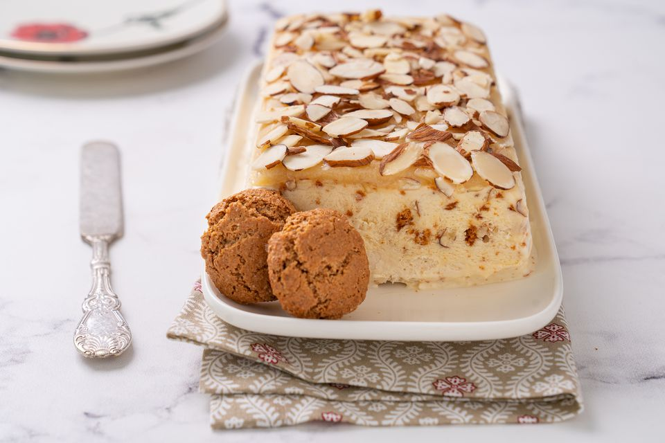 Semifreddo with slivered almonds and cookies on a long platter