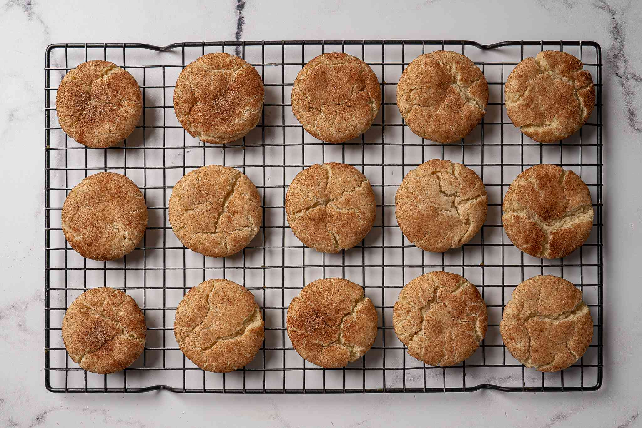 Vegan Snickerdoodles cooling on a wire rack