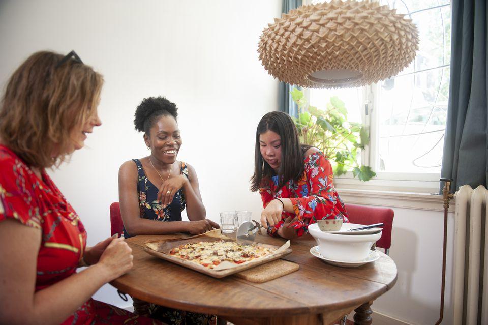women using pizza cutter