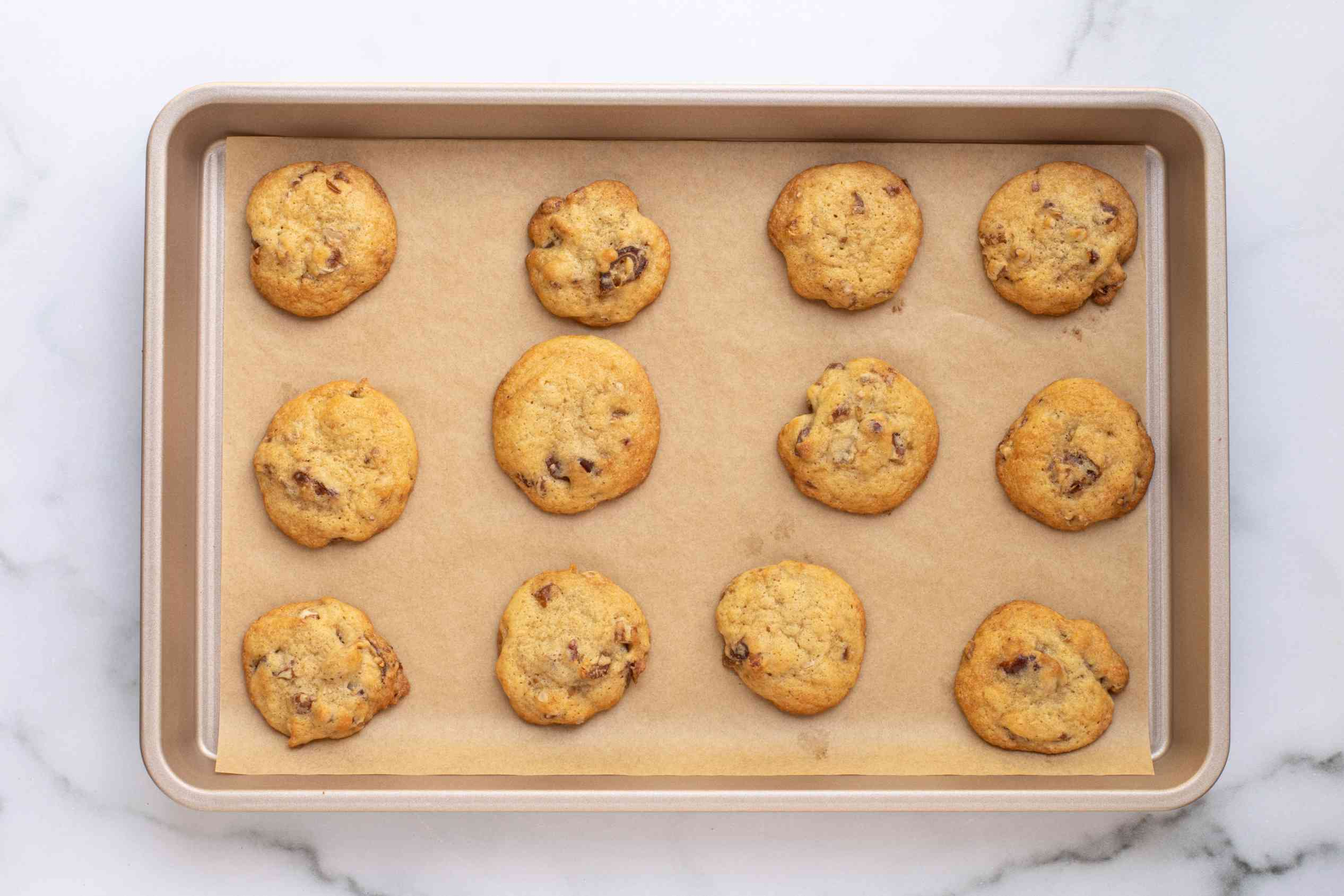 baked date cookies on a cookie sheet