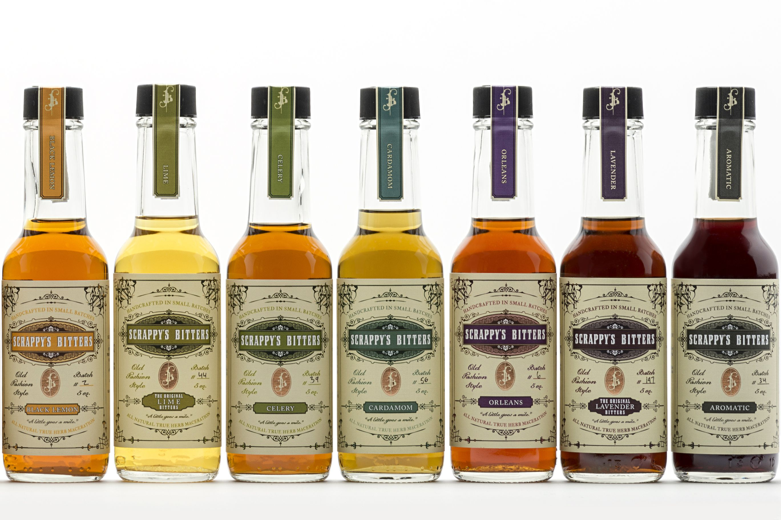 A row of Scrappy's Bitters on a white background