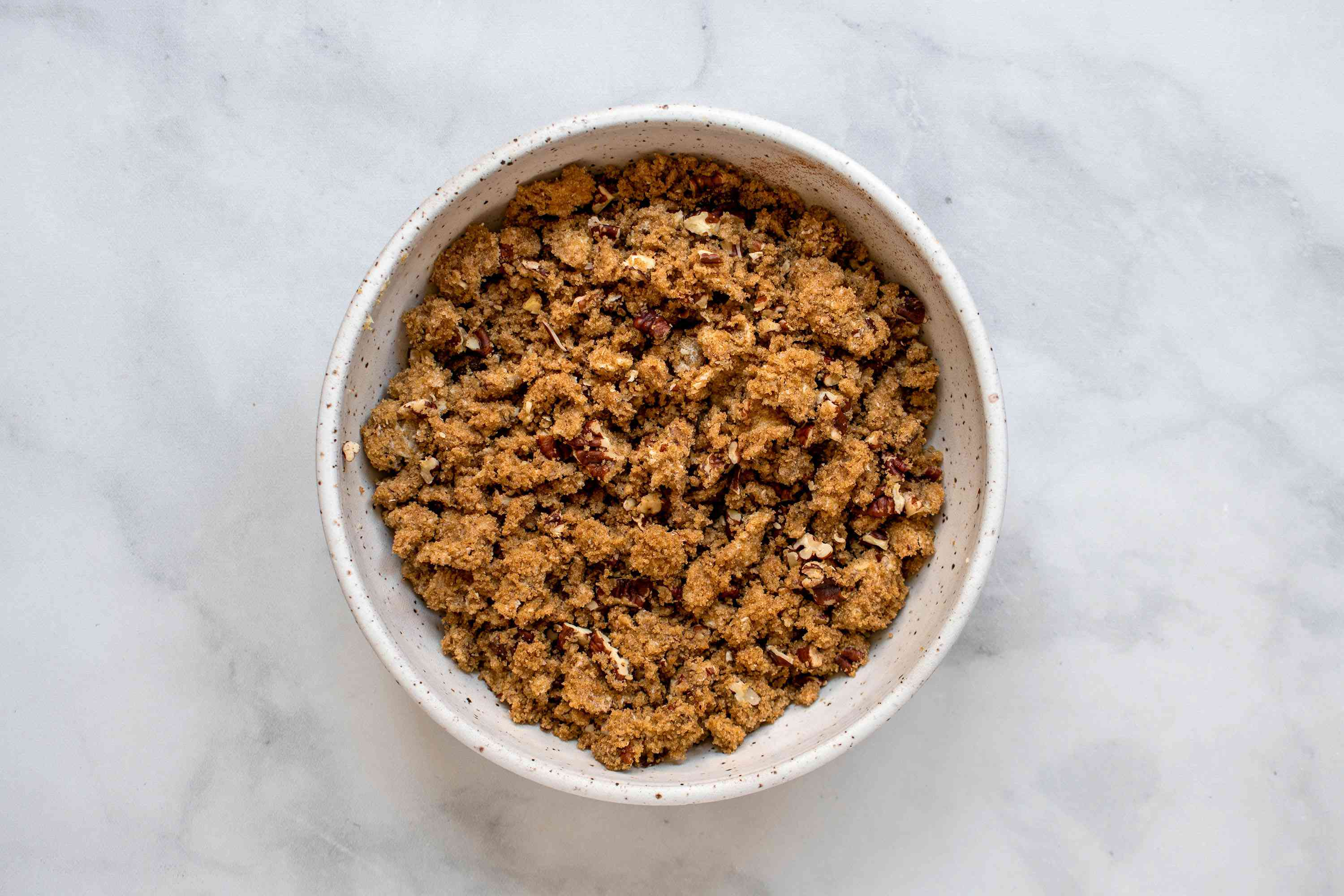 In a small mixing bowl, combine the brown sugar, soy margarine, chopped pecans and cinnamon