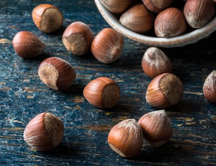 Close-Up Of Hazelnuts On Wooden Table