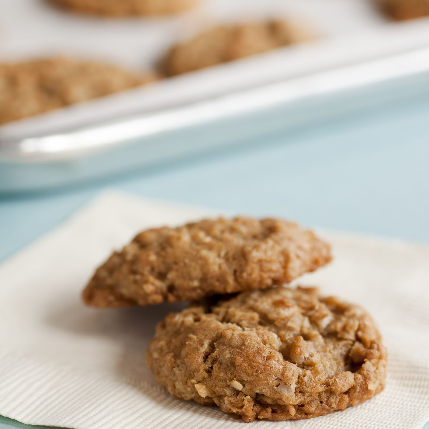 Gluten-free toasted coconut oatmeal cookies on a napkin