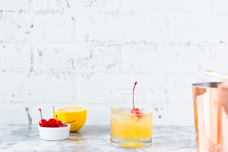 Whiskey sour with maraschino cherries