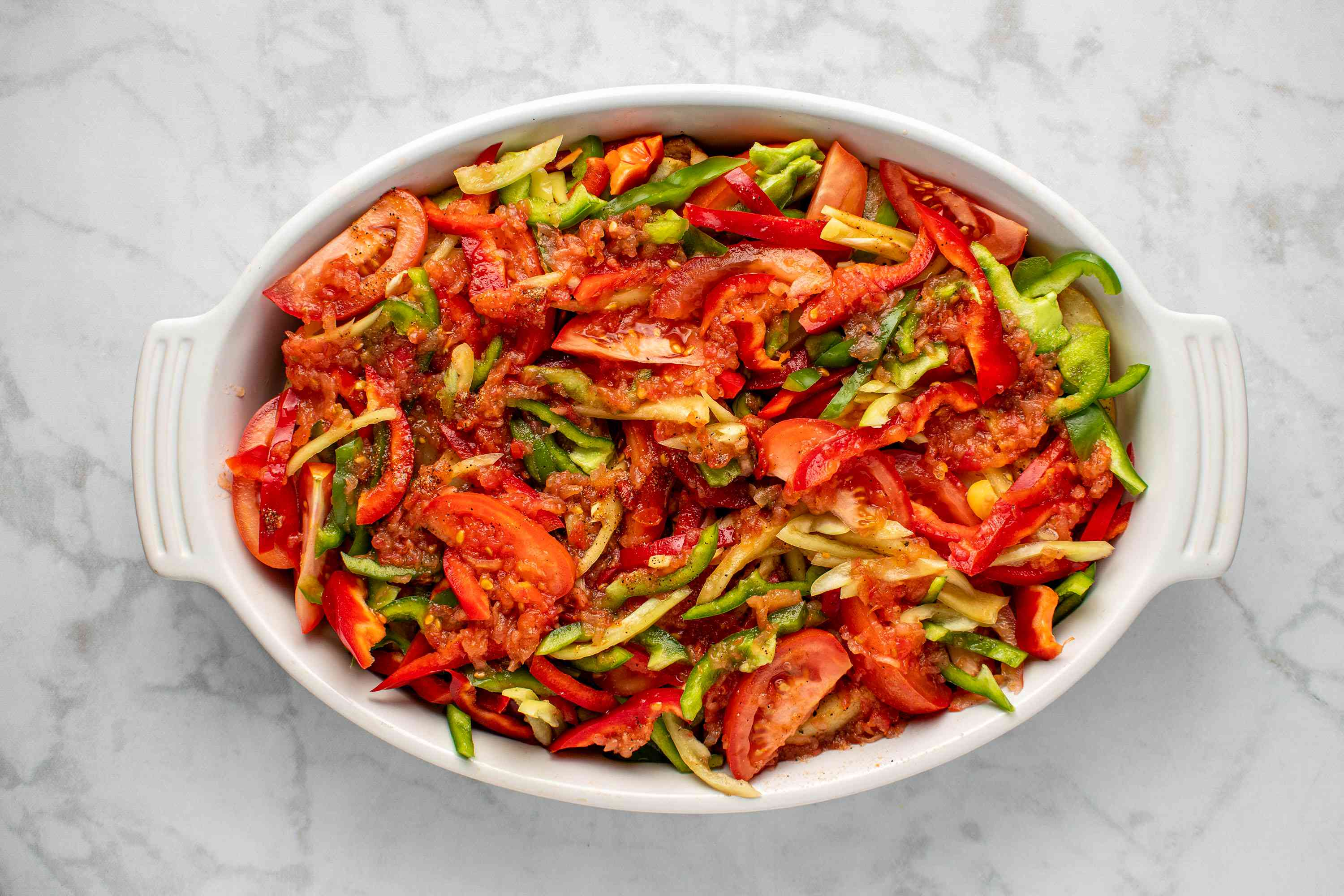 seasoning on top of the vegetables in the baking dish