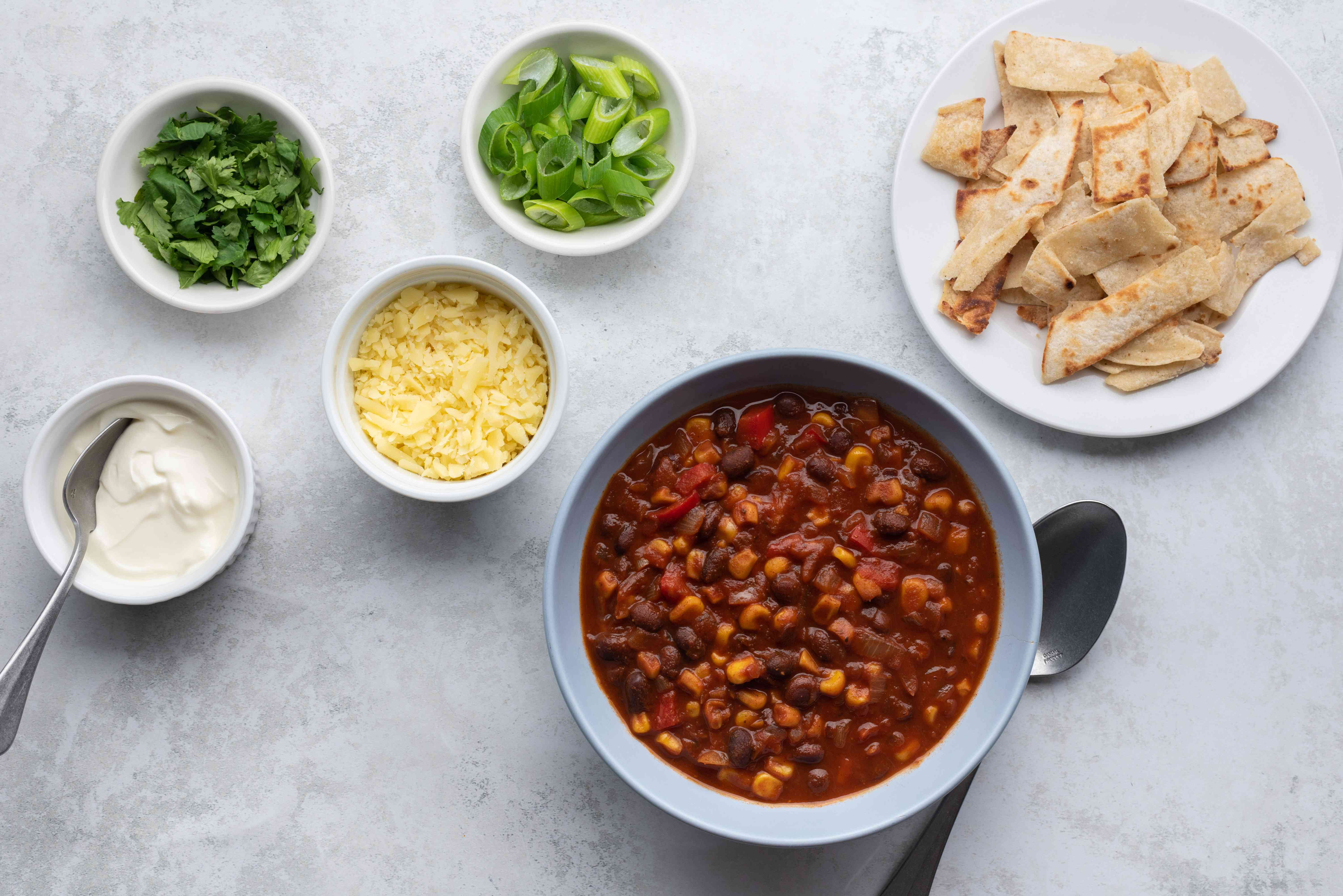Black bean and corn chili with toppings