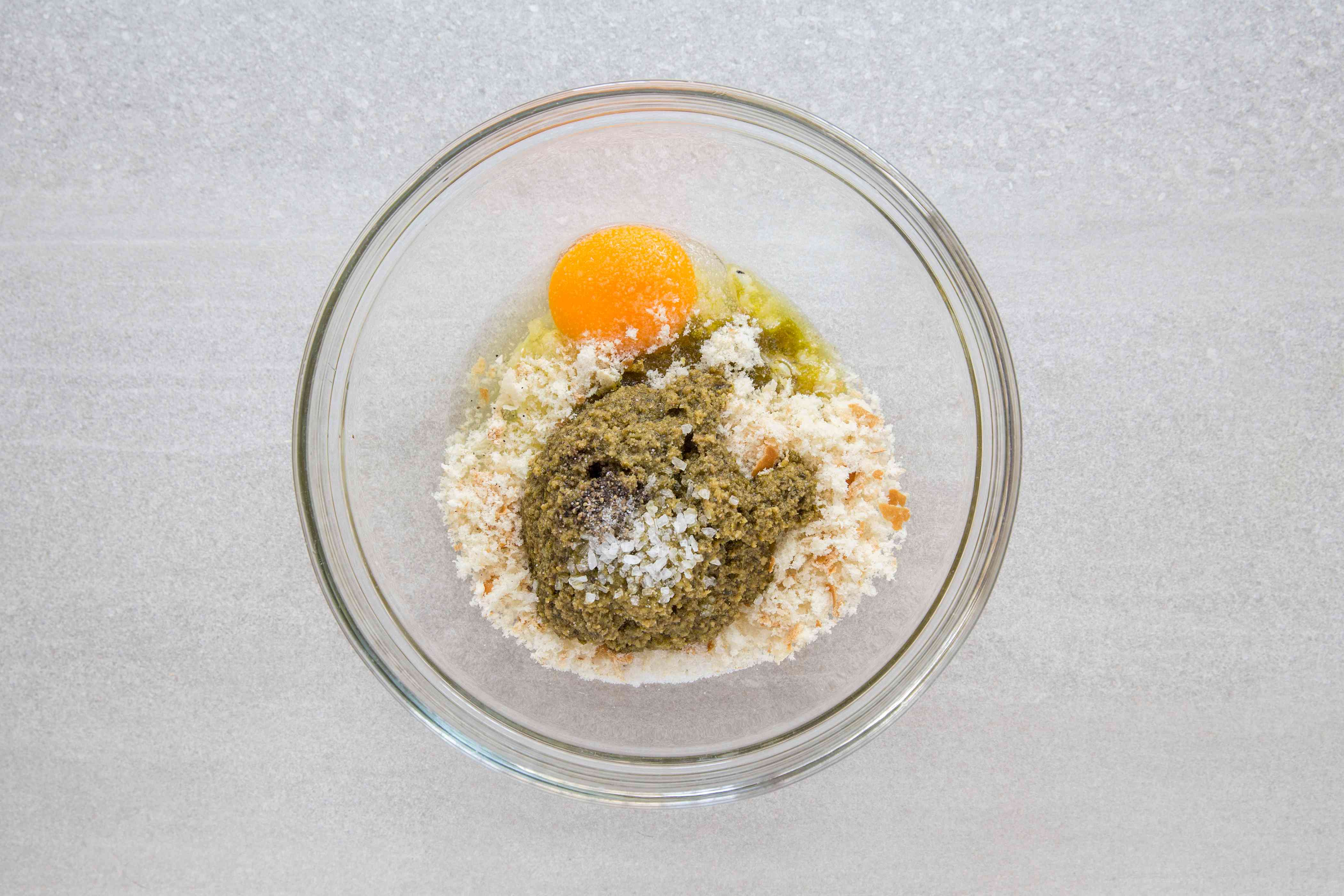 pesto, cheese, egg, bread crumbs, salt, and pepper in a bowl