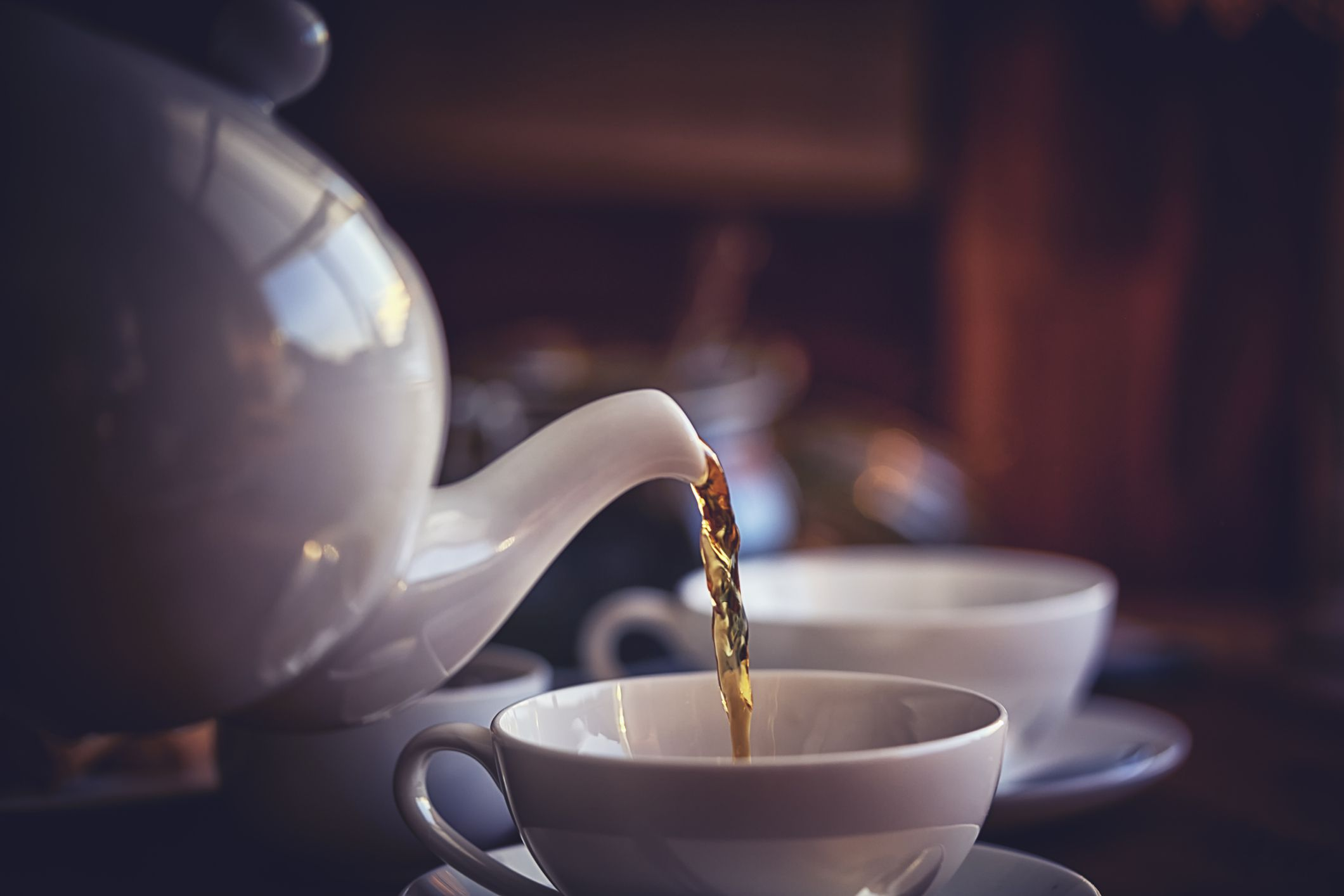 Black tea poured into cup