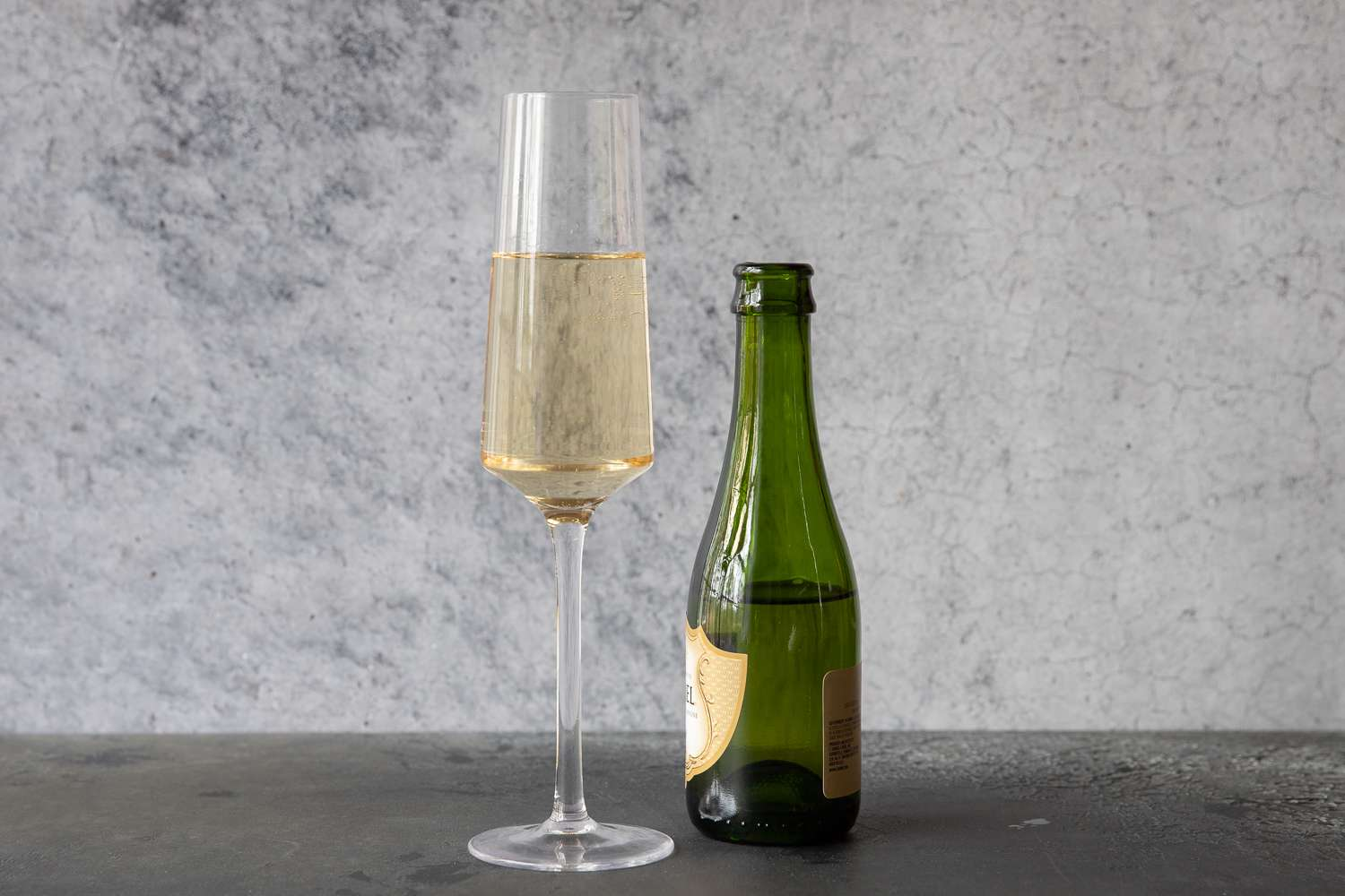 Fill the glass the rest of the way with Champagne