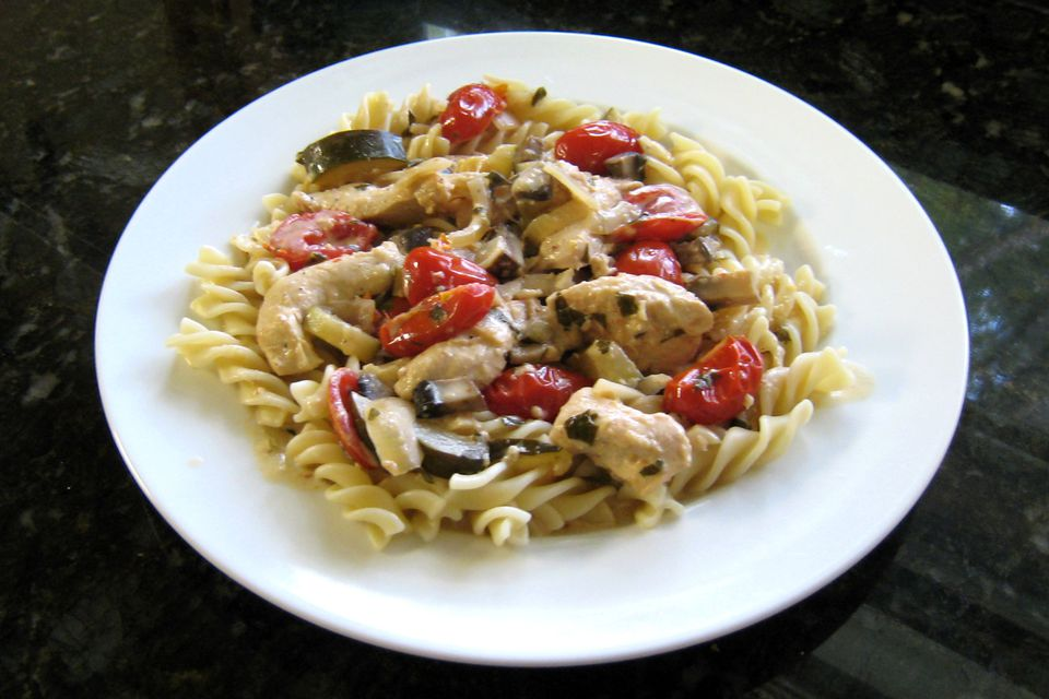 chicken and pasta with lemon cream sauce on a plate