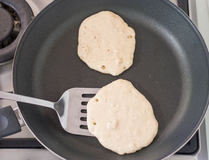 Cook pancakes on one side until golden brown