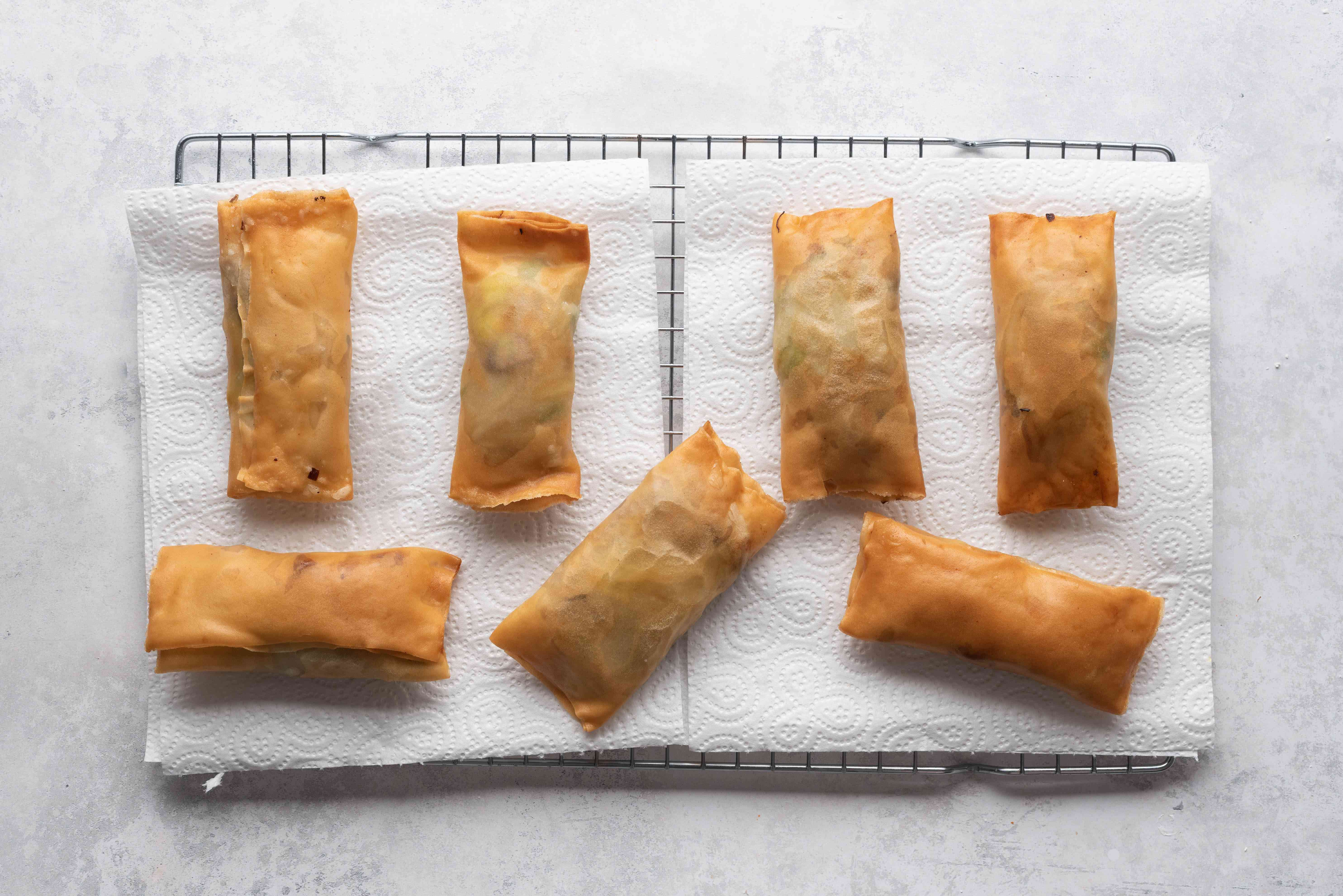 Cooking Chinese Egg Rolls on a cooling rack