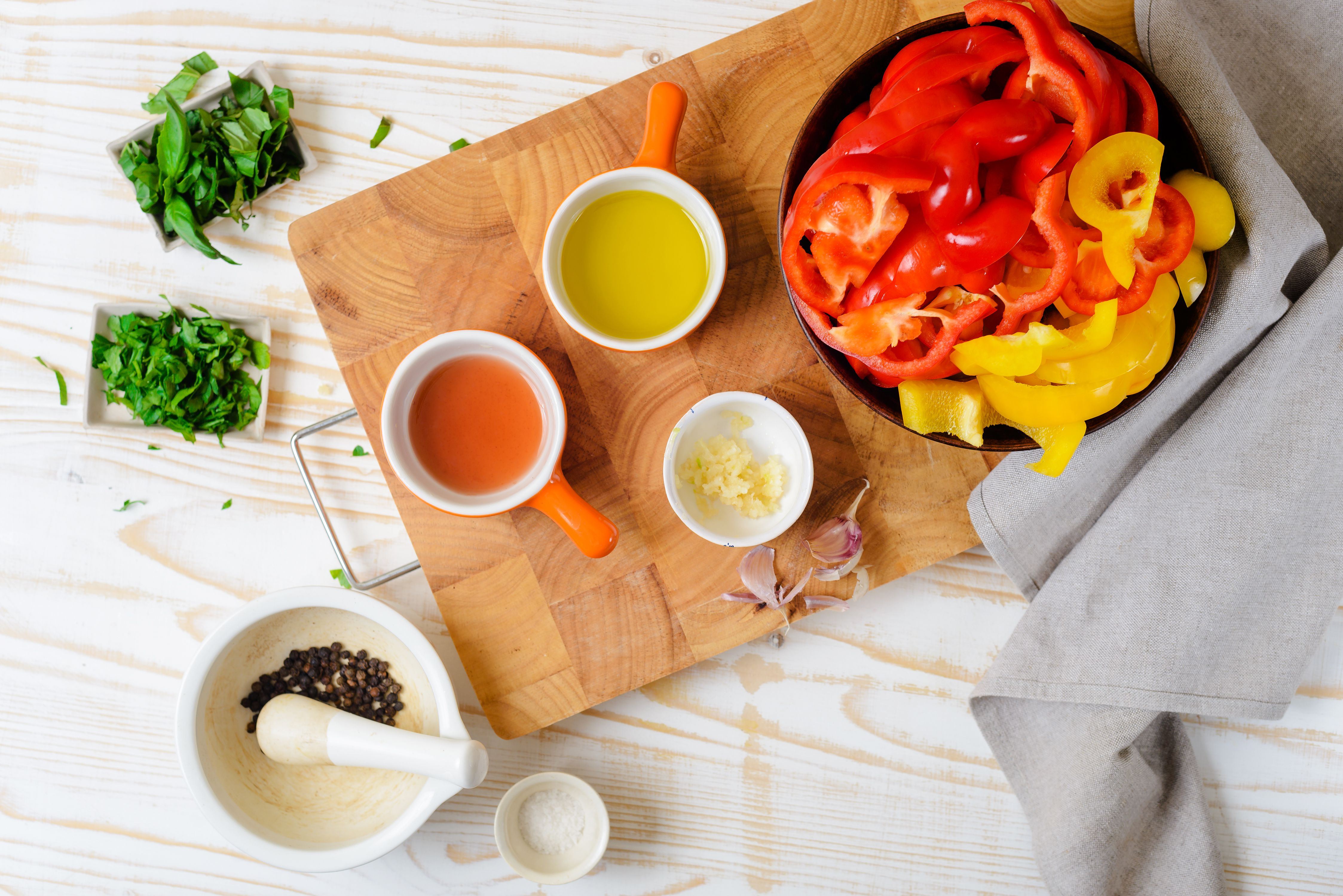 Ingredients for making garlic and herb sautéed bell pepper strips