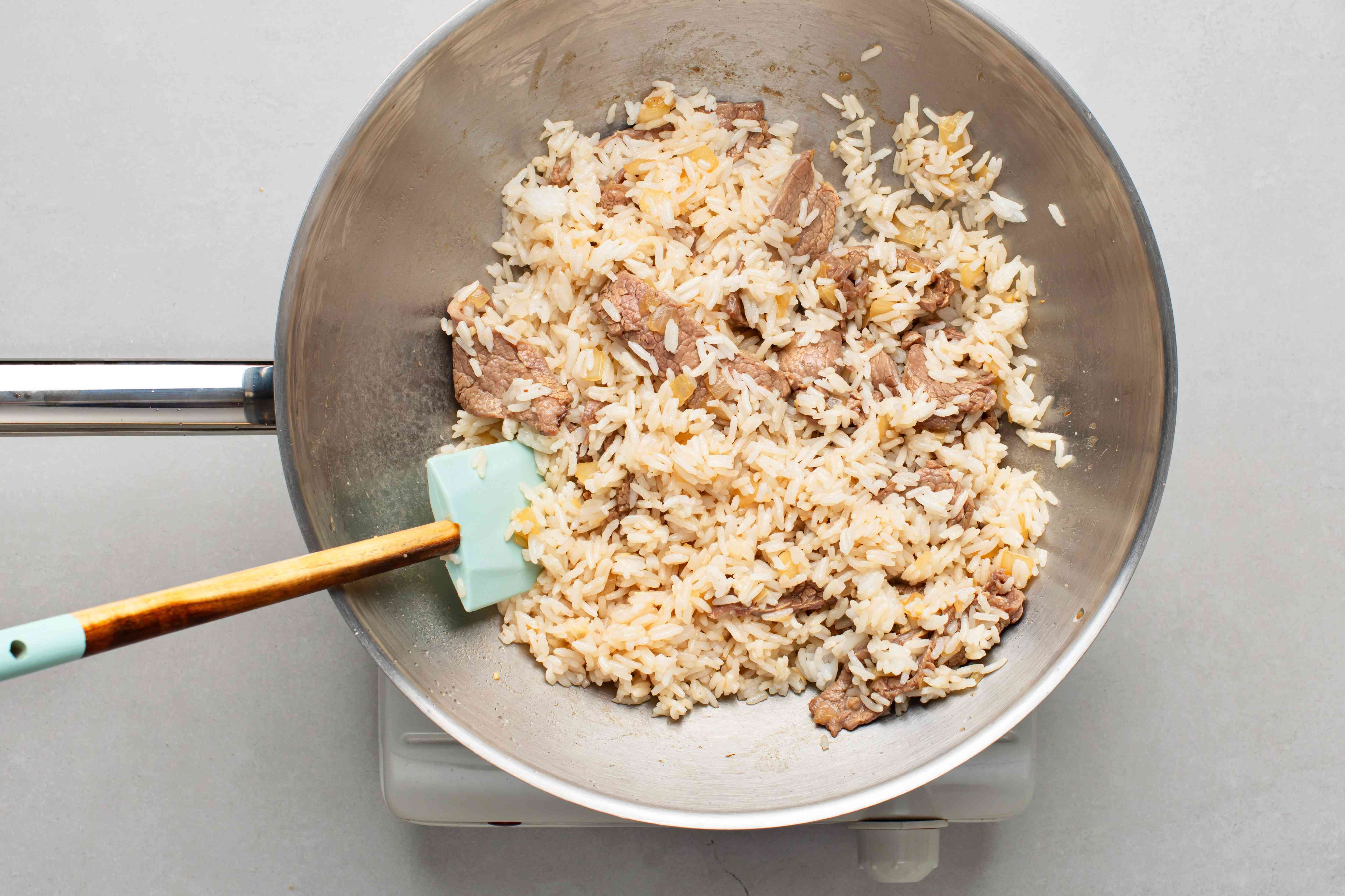 rice and beef cooking in a pan
