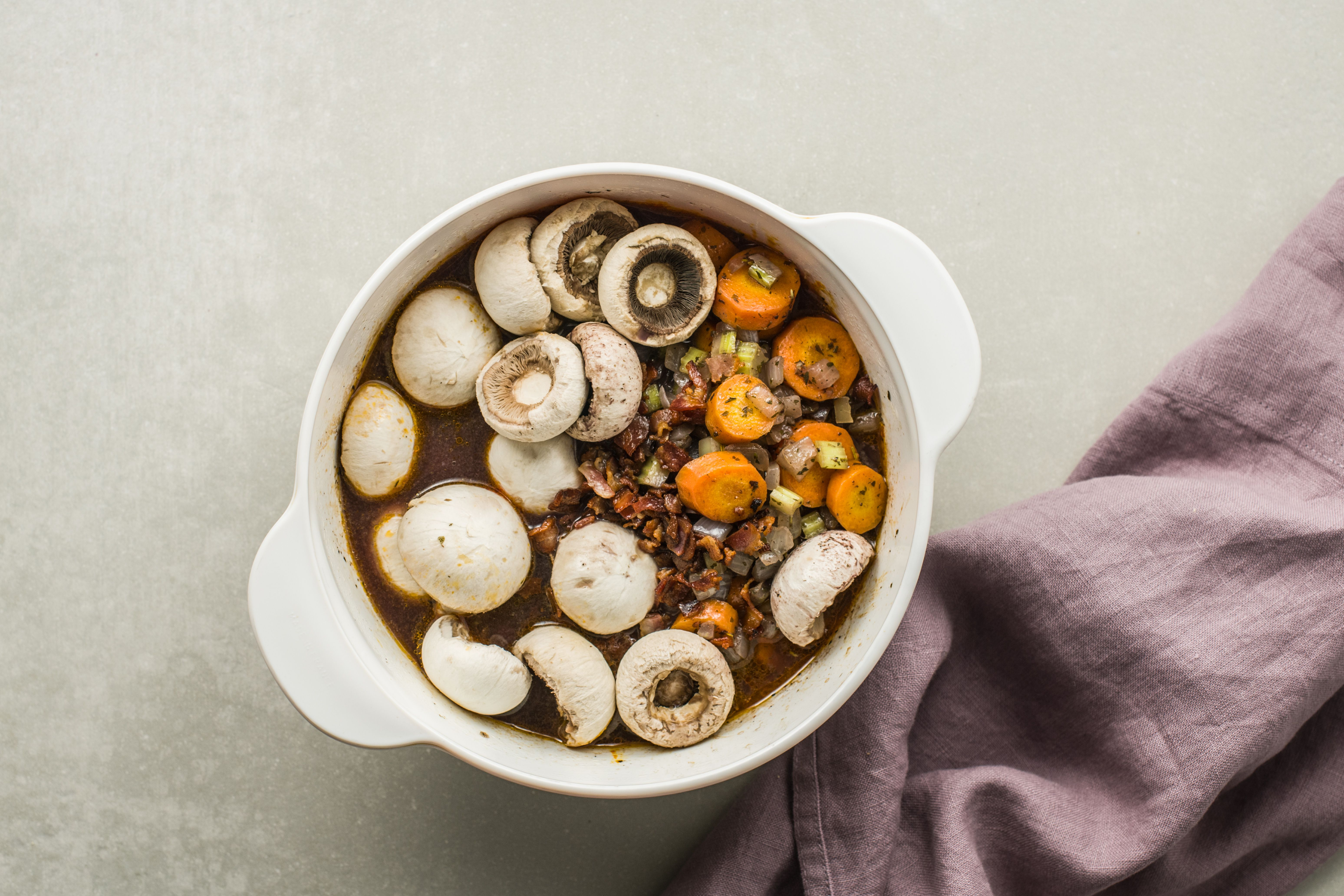 Cooked veggies and mushrooms added to pot with venison for stew