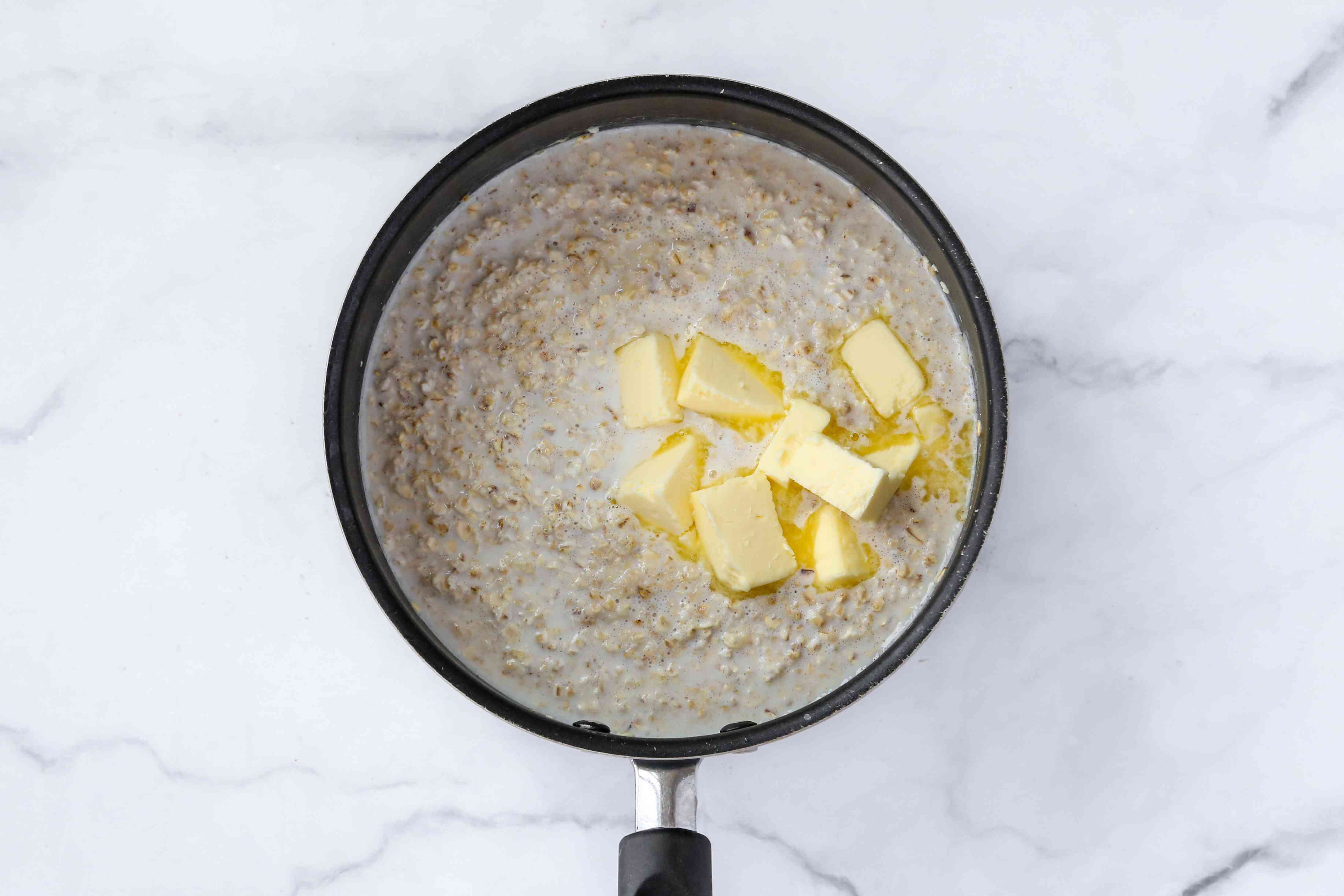 butter added to the oatmeal mixture in the saucepan