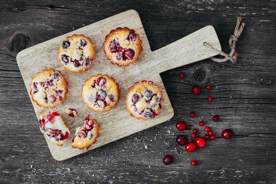 Cranberry muffins on wooden cutting board