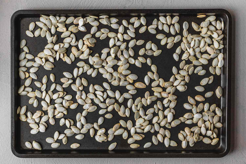 Pumpkin seeds on a baking sheet dried out overnight