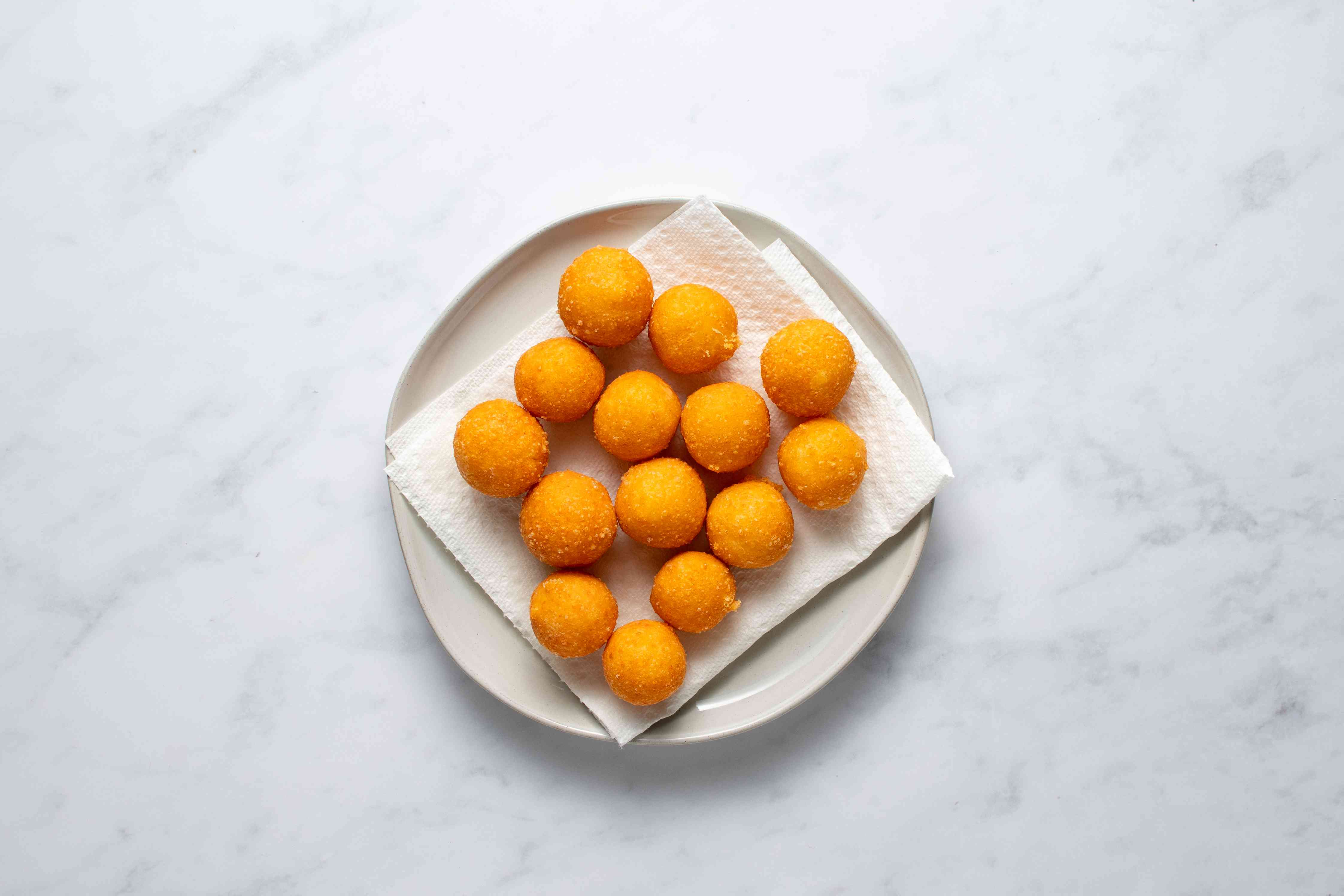 Fried Cheese Balls on a paper towel line platter