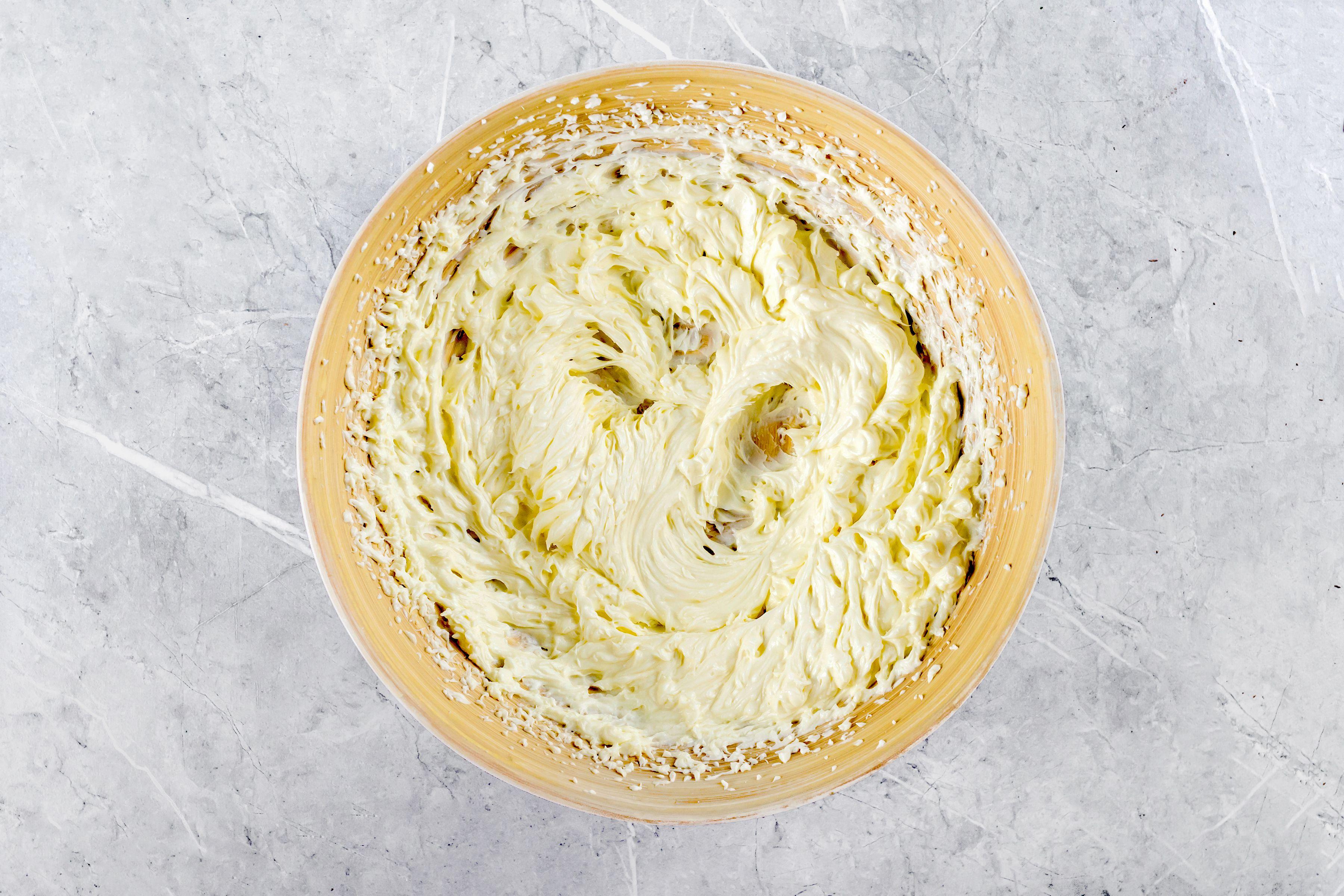 Beat cream cheese