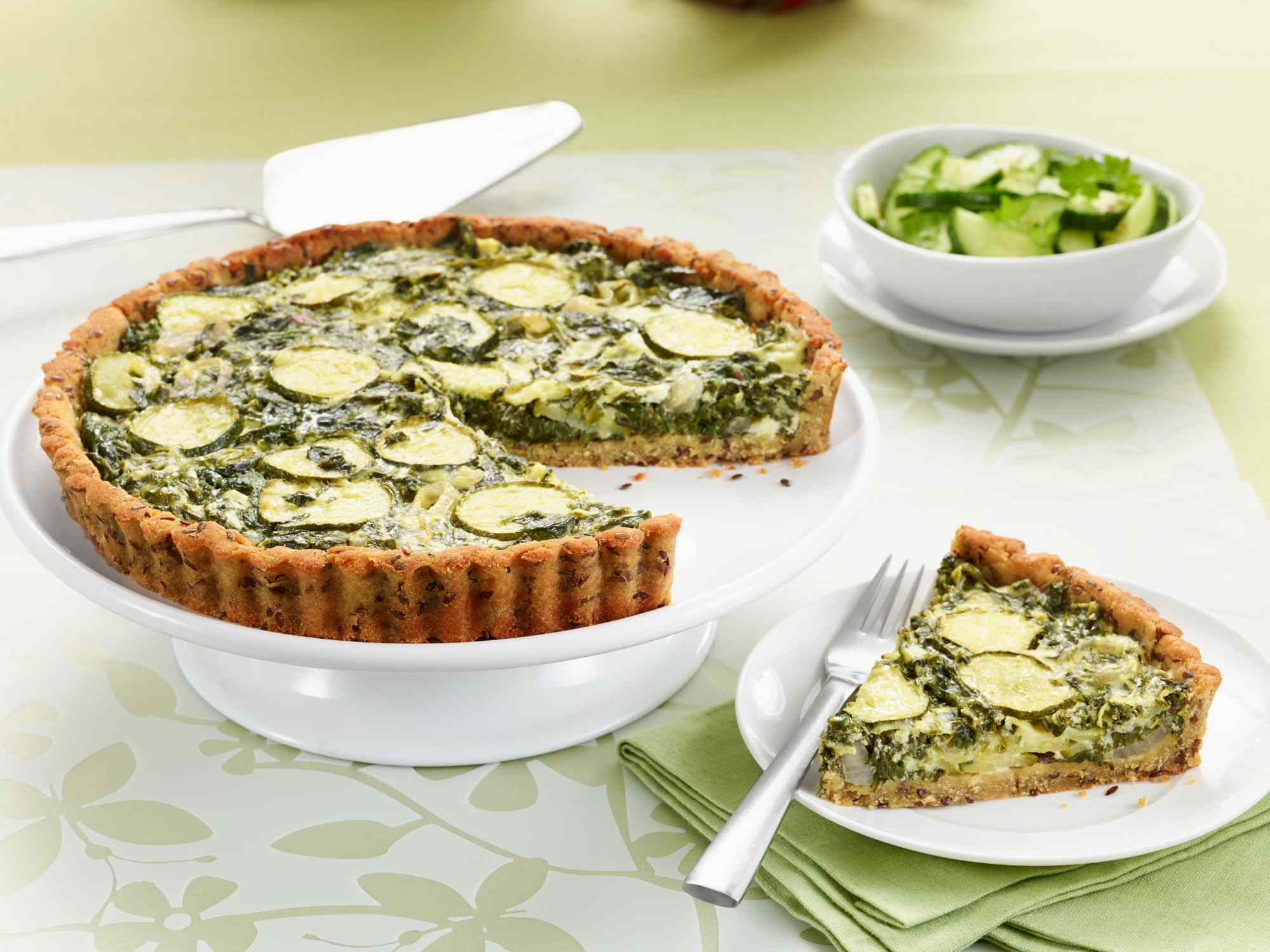 Close up of spinach quiche pie on pie dish